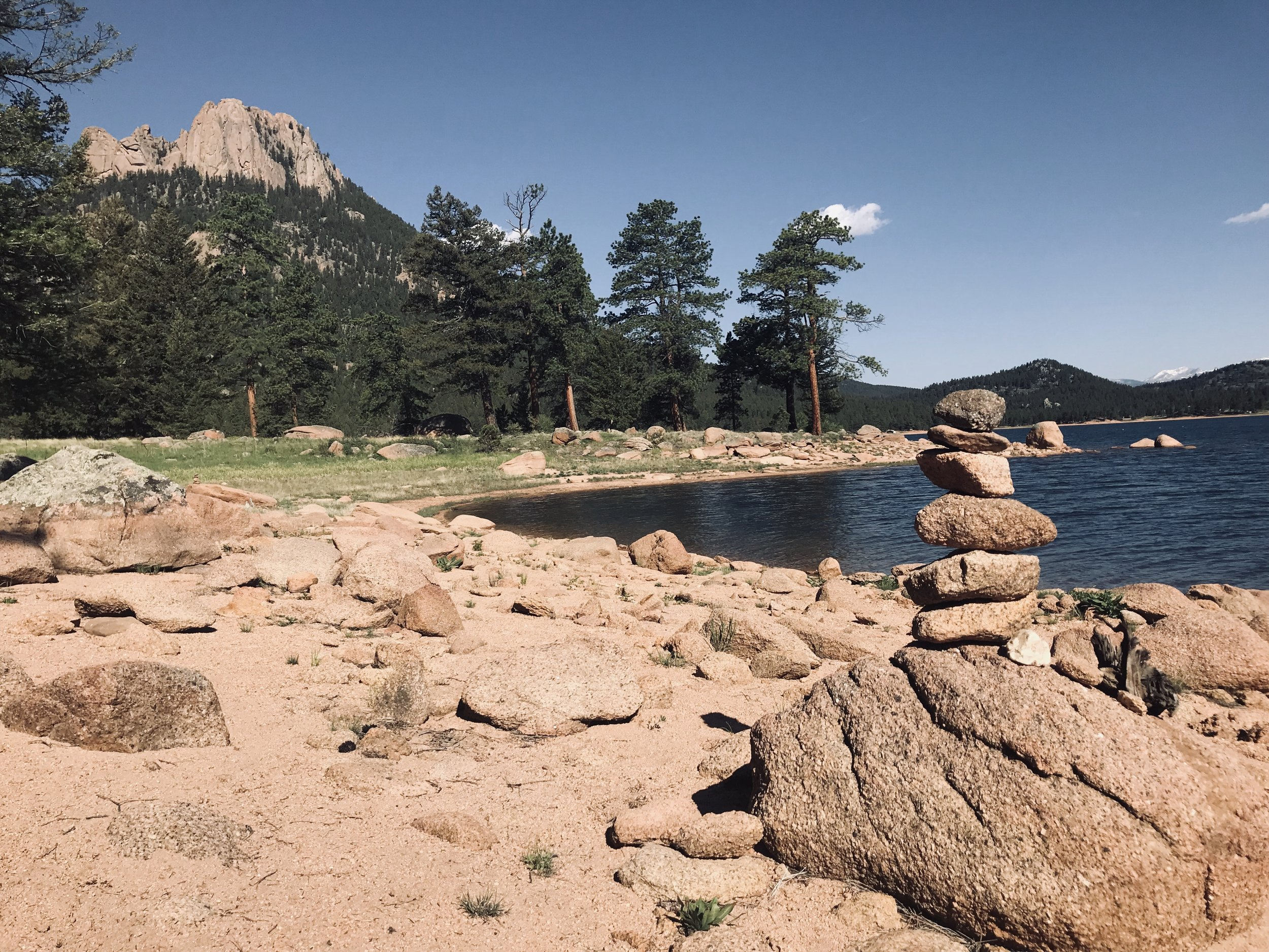 Rock cairns mark the way along the lake trail.