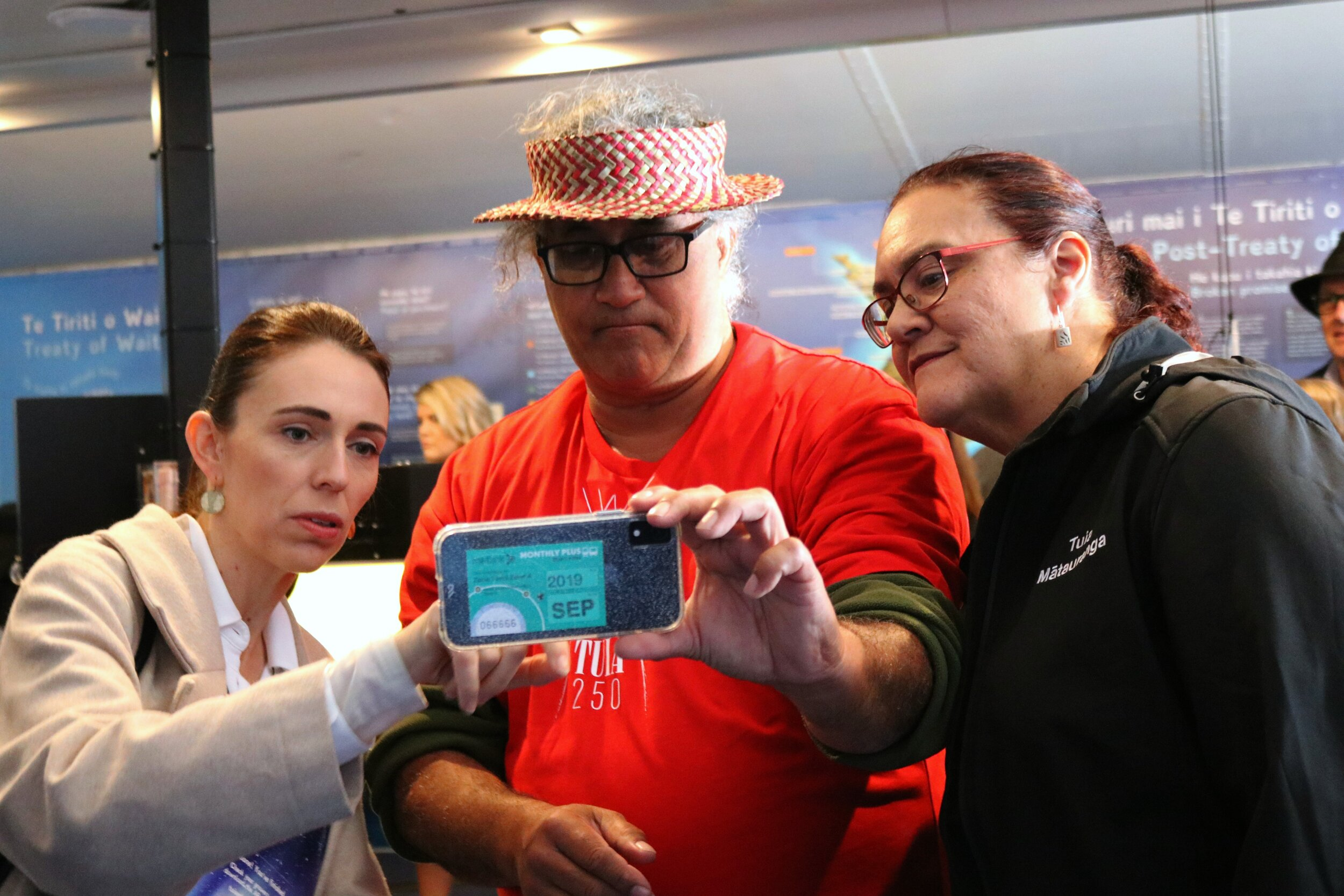 Tuia Mātauranga roadshow opening:  Prime Minister Jacinda Ardern, Tuia 250 National Coordinating Committee co-chair Hoturoa Barclay-Kerr, and Ministry of Education Acting Deputy Secretary of Parent Information and Community Intelligence, Rose Jamieson try out the augmented reality functionality.