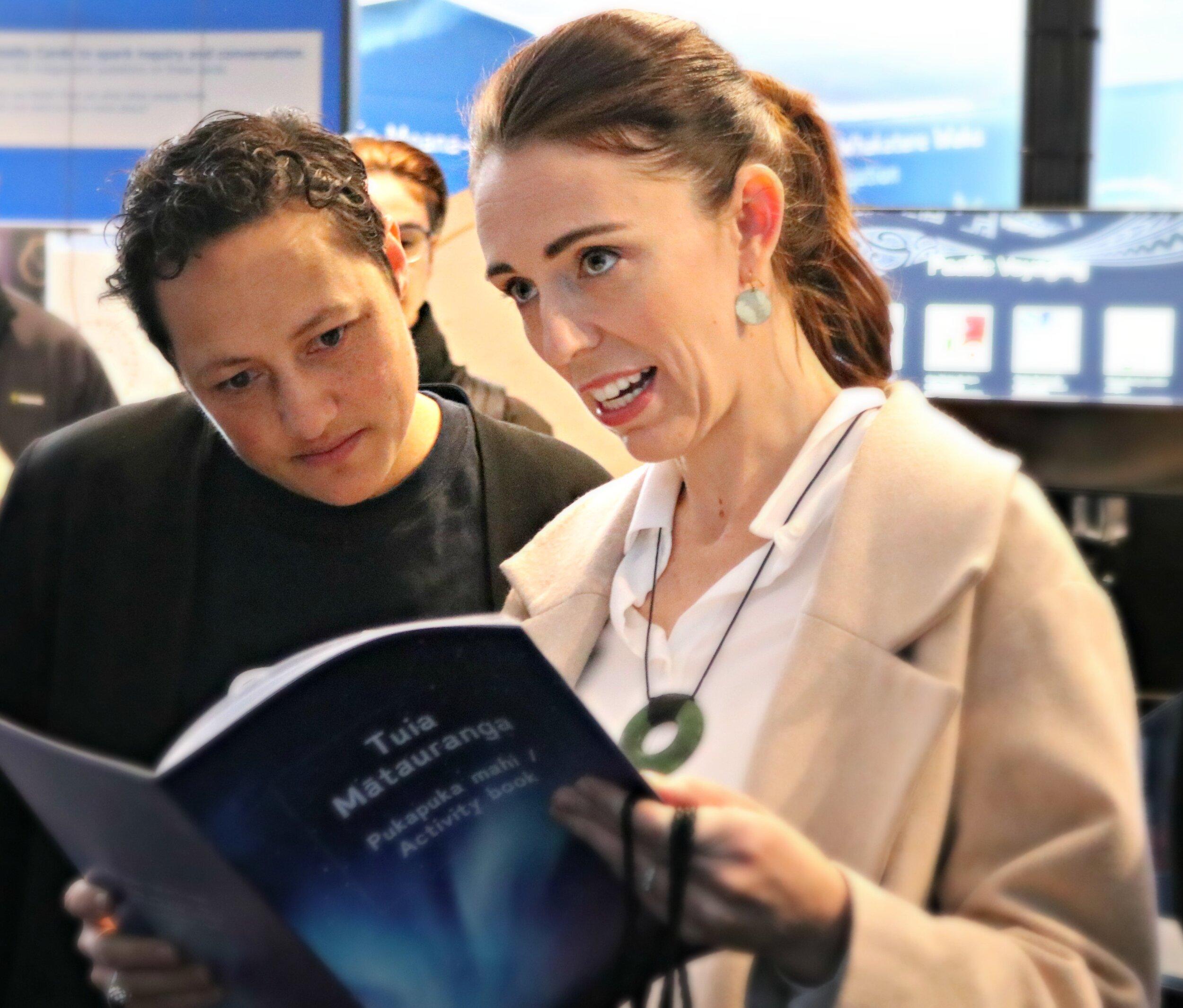 Labour MP Kiritapu Allan and Prime Minister Jacinda Ardern check out the Tuia Mātauranga Activity Books.