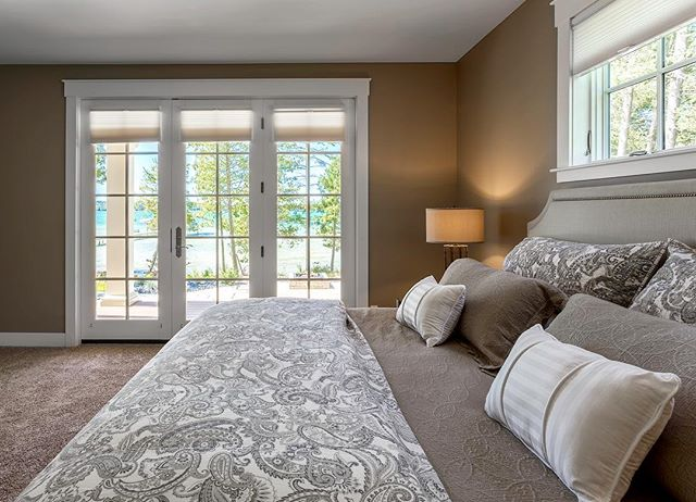A water-front master bedroom with endless views of breathtaking Lake Michigan. #viewsfordays #masterbedroom #interiordesign #lakeside #puremichigan