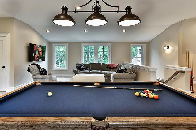 Anybody recognize the movie playing in the back of this lounge room we built? #gameroom #mancave #loungeroom #poolshark