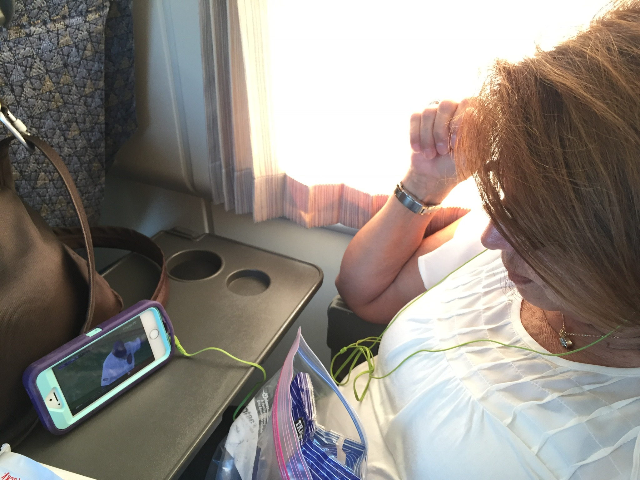 Watching the MLB Post-Season on our phones during our train ride. Let's go A's!