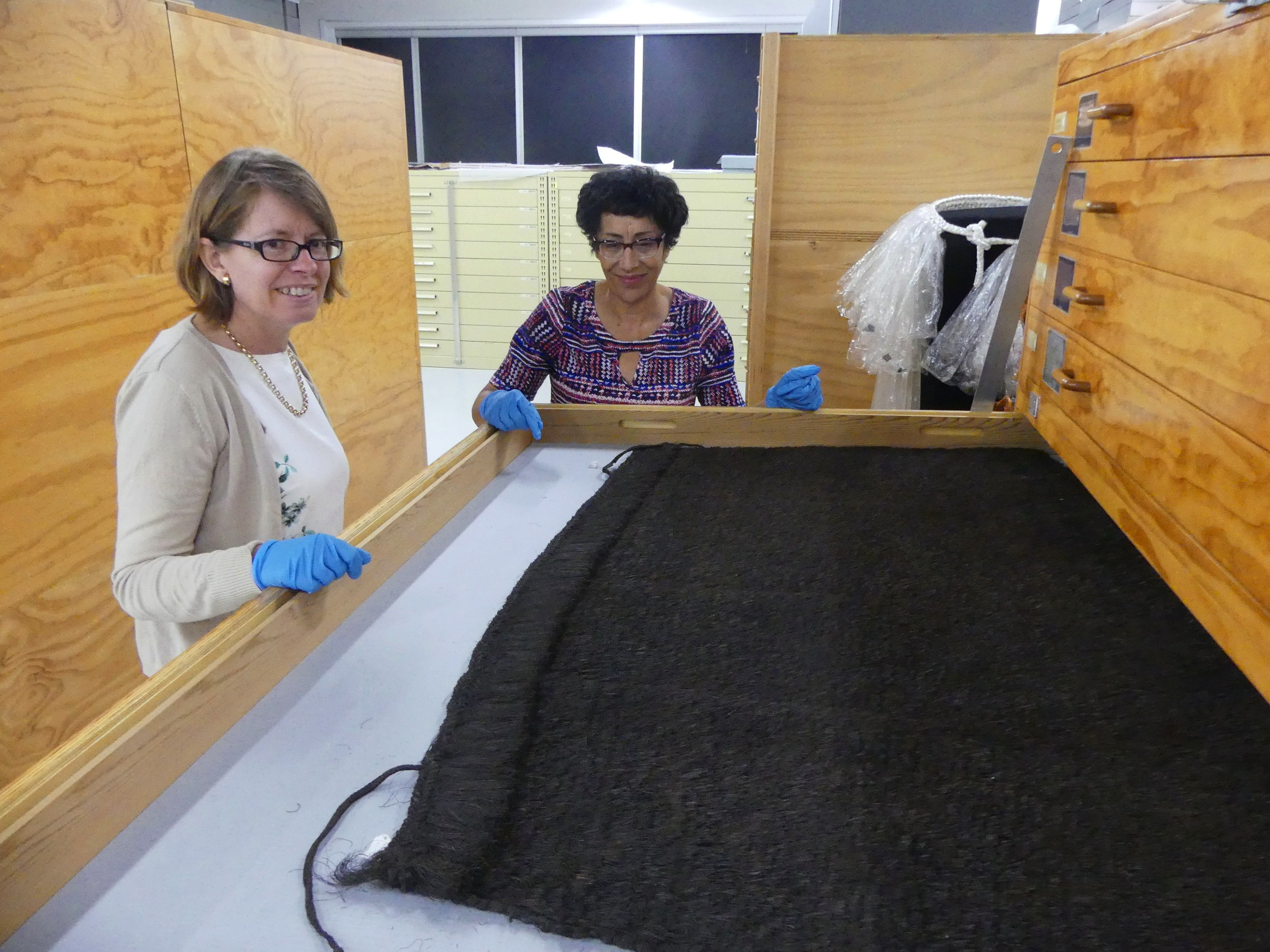 GNS Science forensic geochemist Karyne Rogers and Te Papa textile conservator and researcher Rangi Te Kanawa, Te Papa archives (image by Jacqui Gibson).