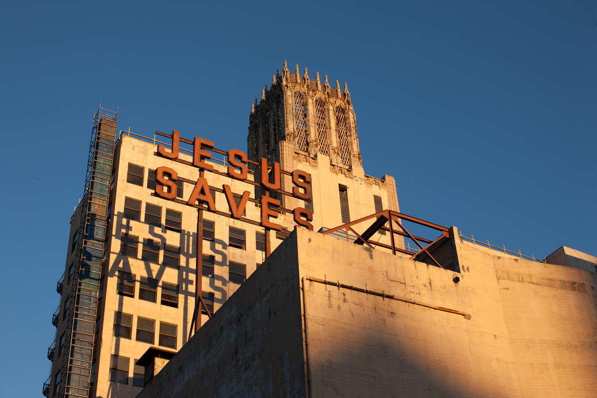 The famous exterior of the Ace Hotel, Los Angeles. The neon sign is a remnant of the building's previous life as an evangelical church (image courtesy of the Ace Hotel).
