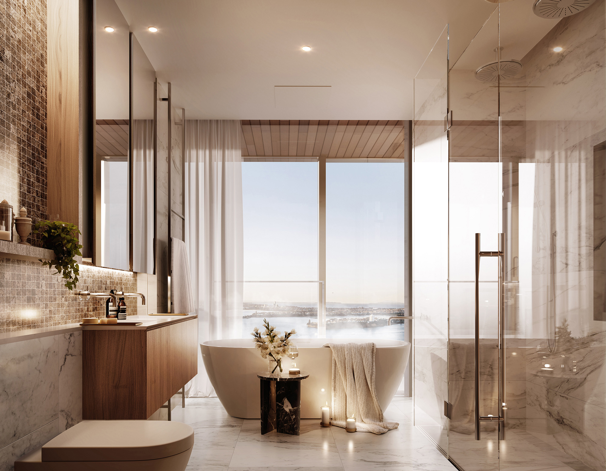 The ensuite features a double vanity, double shower and freestanding bath with views to the harbour beyond.