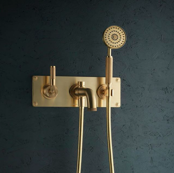 Gold shower taps - Instagram @samuelheathofficial