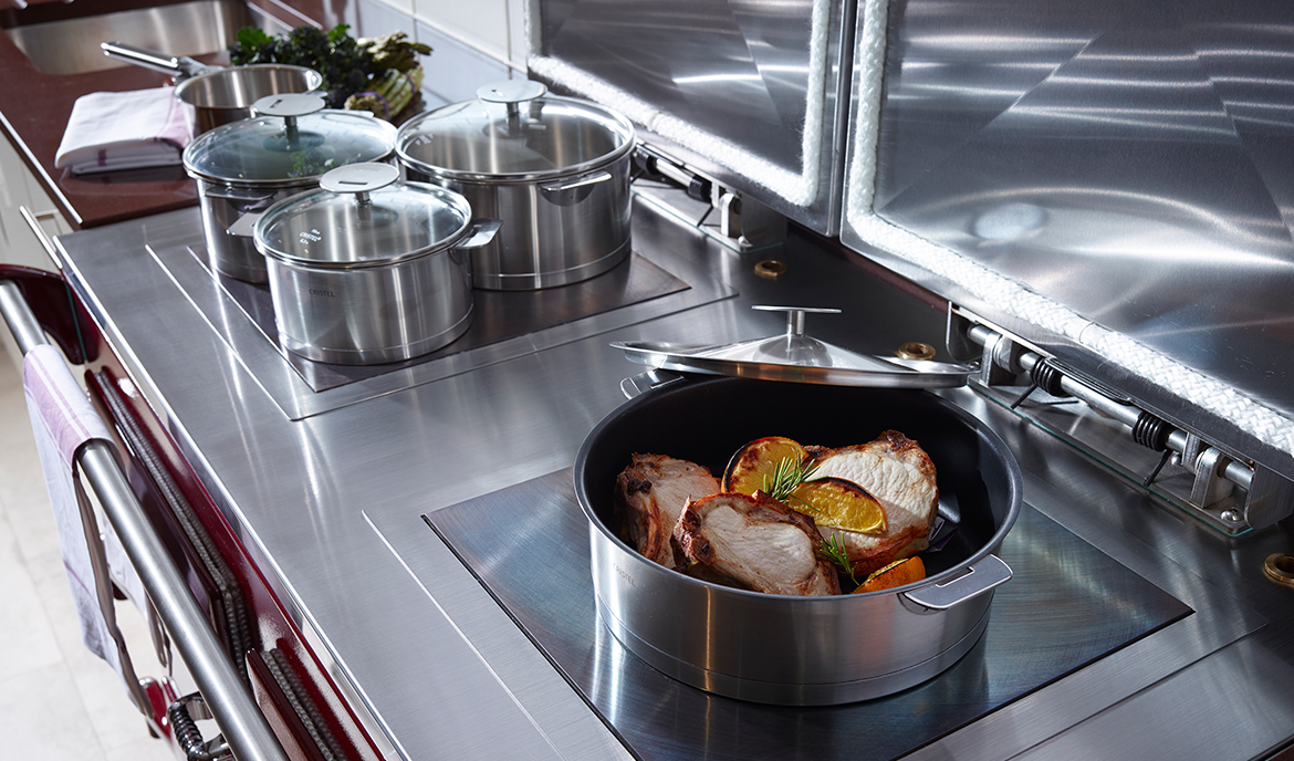 Everhot 110+ - The Everhot 110+ offers the classic configuration of cast iron hot and simmer plates under separate lids, both of which are independently controllable. In addition, this cooker has three ovens; ideal for those customers who want to have a roasting, baking and slow cooking set up. The fourth door provides access to the controls of the cooker.