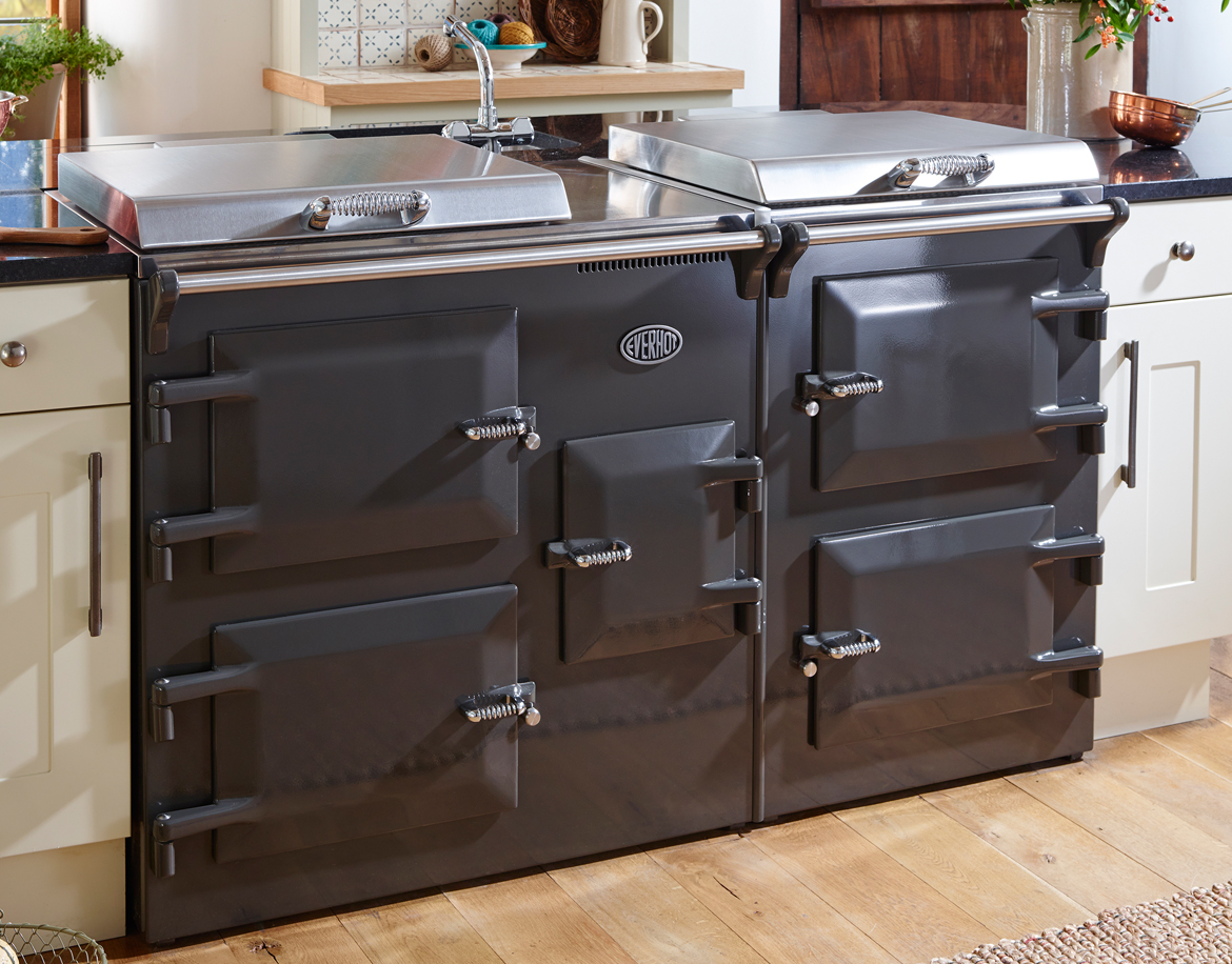 Everhot 150 - The Everhot 150 has four large ovens and a wealth of cast iron hotplate capacity, as well as two grills, integral controls and a useful resting plate positioned between the hotplates. As with the Everhot 120, this is the ideal cooker for those who require more heat in their kitchen.
