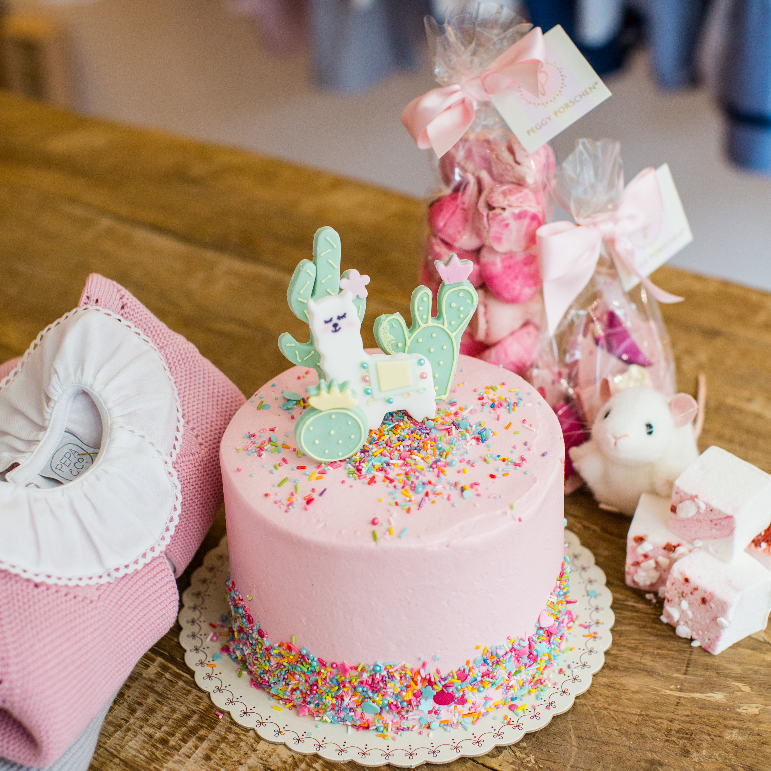 Photographer for Pepa and Co, Prince George's favourite childrenswear shop Belgravia Store, London - photo of Peggy Porschen Llama birthday cake in pink with Pepa and Co childrens clothing