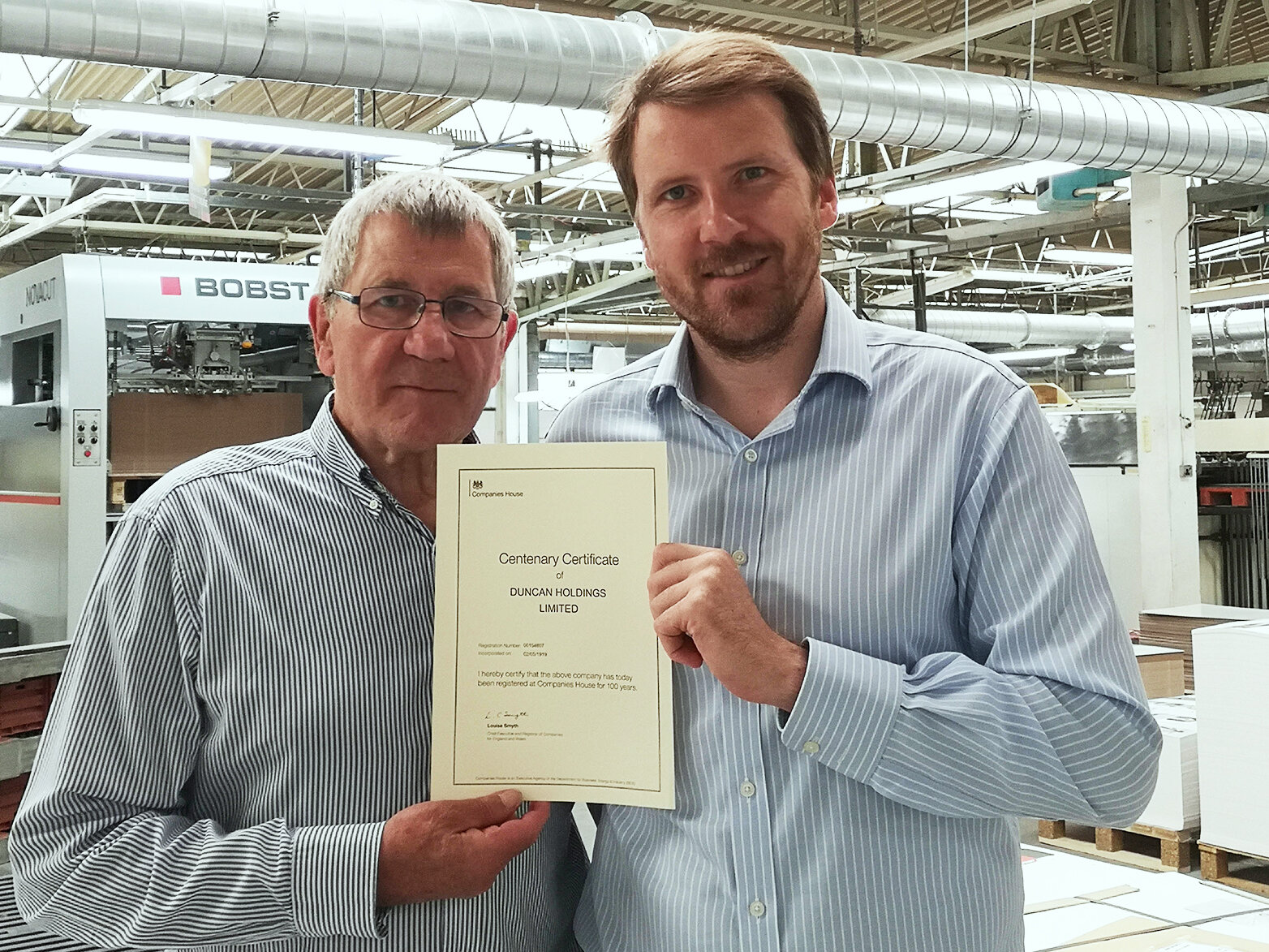 Pictured: Bill Duncan, Managing Director and James Duncan, Deputy Managing Director with the Companies House Centenary Certificate
