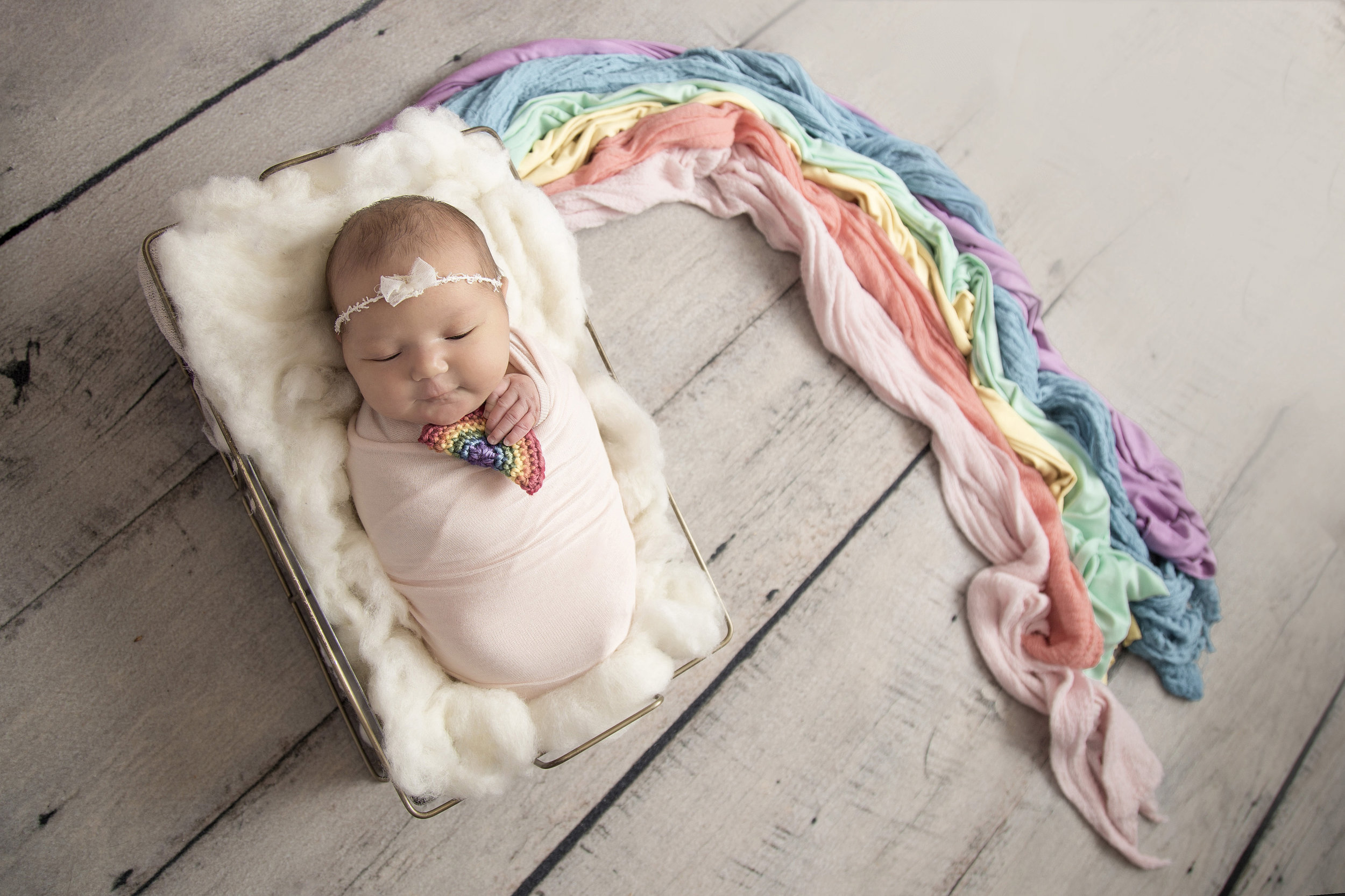As a follow up to Stephanie's maternity image that made the reel, I am also including her sweet rainbow baby girl.