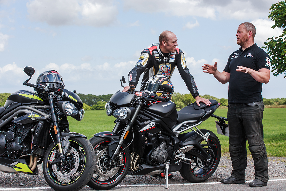 Rapid pro coach Ryan discussing on road techniques with Isle of Man TT legend Pete Hickman, during his BIKEMASTER™ taster day.