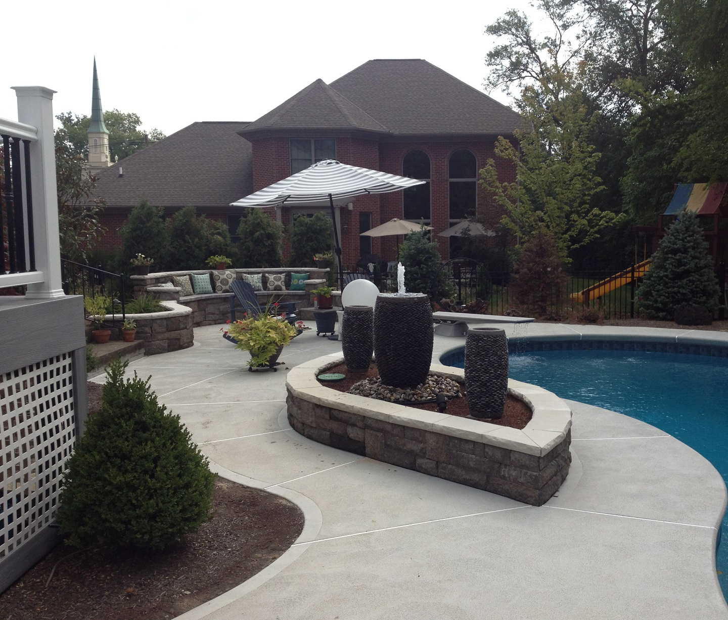 Custom pool patio with water features in West Chester, Ohio