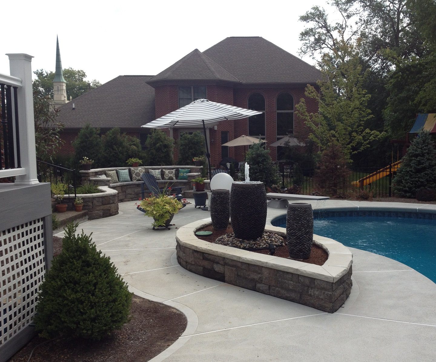 Custom pool patio in West Chester, OH with water features