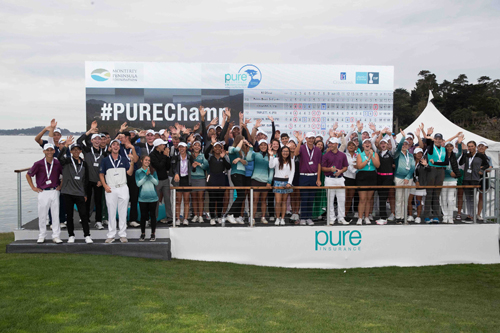 The junior field gathers in front of the scoreboard at the 2018 PURE Insurance Championship.