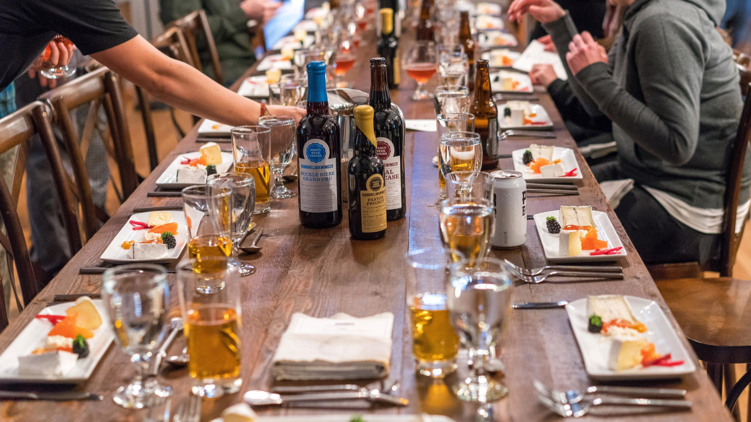 The table is set with Chef's culinary and brewing work product.