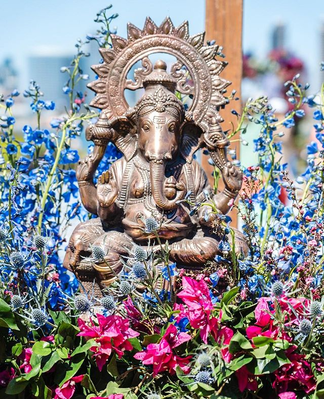 Ganesh is traditionally known to be the Remover of Obstacles, the Lord of Beginnings, and the Deity of Good Fortune. Putting this at the beginning of the aisle not only clears the path for the newlyweds, but introduces good fortune into their marriage. We like to enhance the statue with flowers, because not even Ganesh can refuse flowers.   Venue: @coronadomarriot Coordinator: @sweetlovedesignssd Photo/Video: @anzafotofilm DJ/Lighting: @3dsounds Decor: @hellokismet Caterer: Delhi Palace, Coconut Man Priest: Ravi Trivedi Hair & Makeup:@makeupby_nini @dolledupbylulu Desserts: Social Kitchen Creative @gelatoparadiso Boat Rental: Seaforth Boat Rental Entertainment: Anish Shah Chairs: Chiavari Chairs of San Diego Paanwalla: Jayesh Shah Transportation: Sun Diego Charter Musician: @joshvietti + + + + #weddings #weddingday #weddingphotography #bride #weddinginspiration #weddingphotographer #bridal #weddingideas #weddingplanning #brides #eventdecor #eventdesign #eventstyling #eventplanner #Indianwedding #SouthAsianwedding #californiaindianweddings #Indianwedding#Indianweddingdesign #SouthAsianweddingvenue #Pakistaniwedding #mandap #Indianweddingceremony #traditionalwedding #orangecounty #southasianbride #indianbride #mehndi