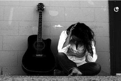 sad_woman_guitar.jpg