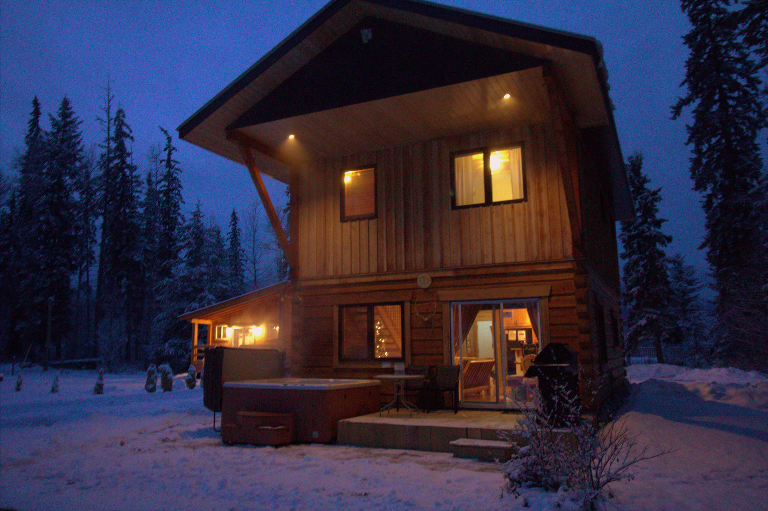 Lodge with hot tub at night.jpg