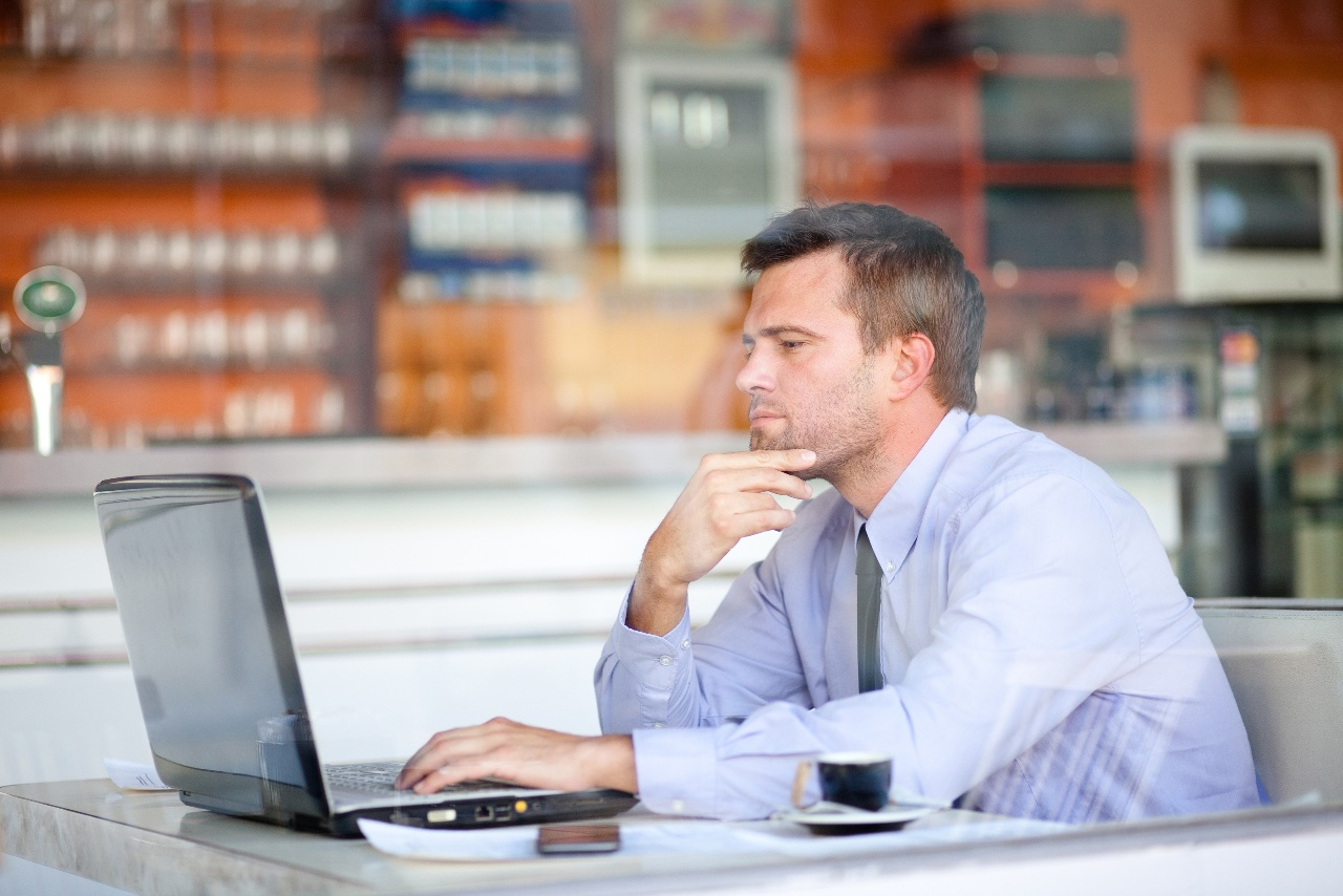 pensive businessman in a cafe.jpg
