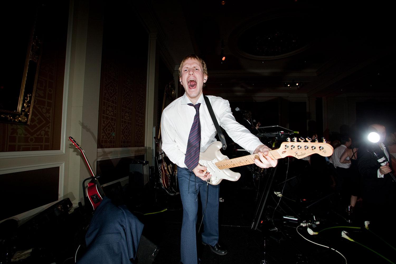 Wedding-Musician-White-Guitar-NY-Times-Andrew-Hetherington.jpg