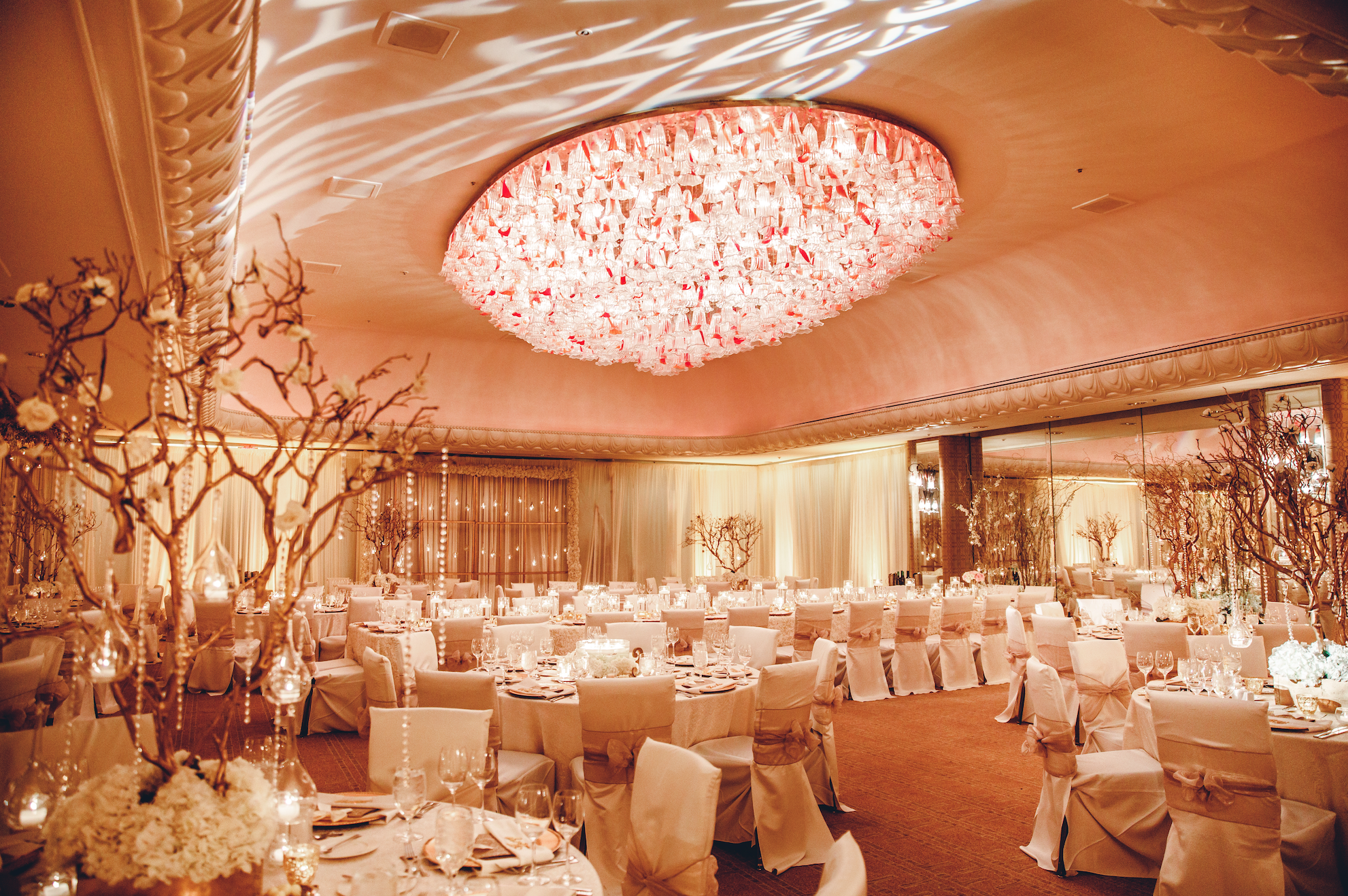 Weddings and formal events demand an effortless glow, achieved here through perfect tonal balance and artful projections on the ceilings and walls.