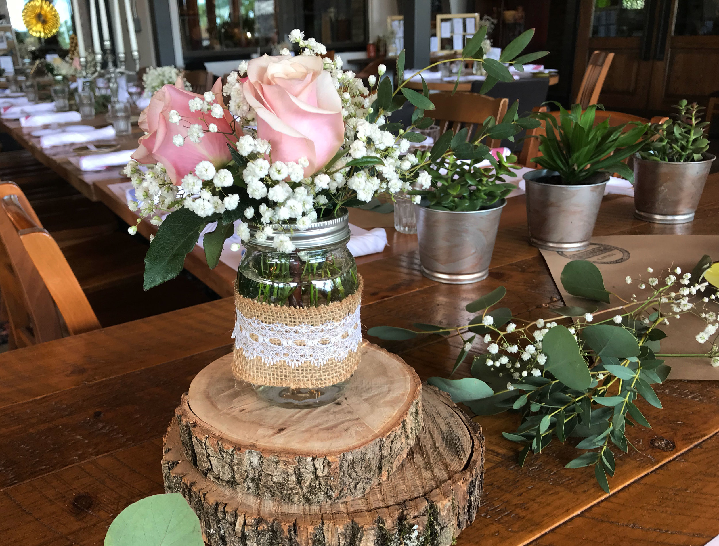 diana-andres-rustic-mason-jar-rose-centerpieces.jpg