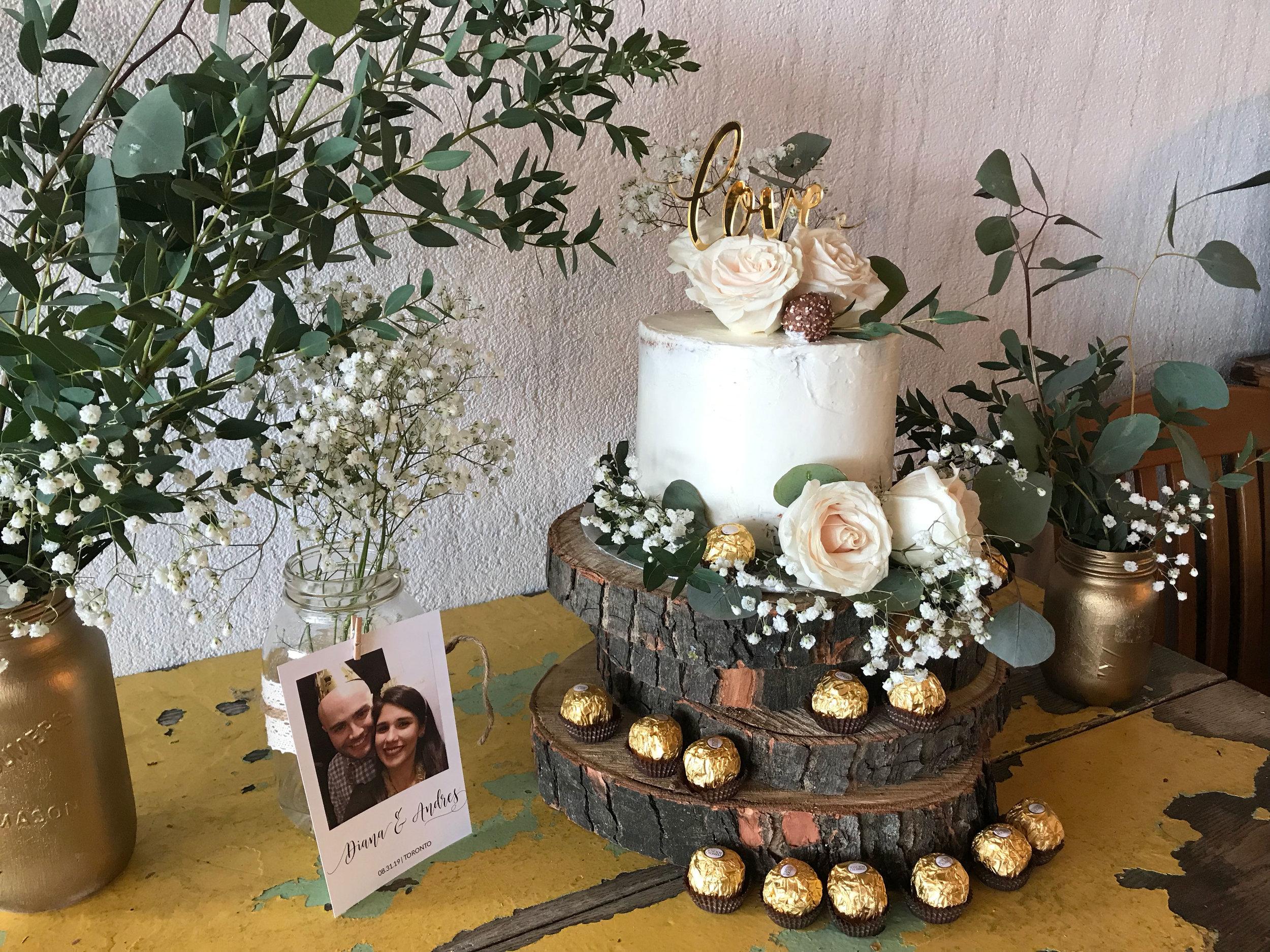diana-andres-rustic-harvest-cake-table-naked-cake-eucalyptus-wooden-discs-ferrero-rocher-cake-topper-love-polaroid-mason-jar-centerpeices-greenery-tyscany-wedding.jpg