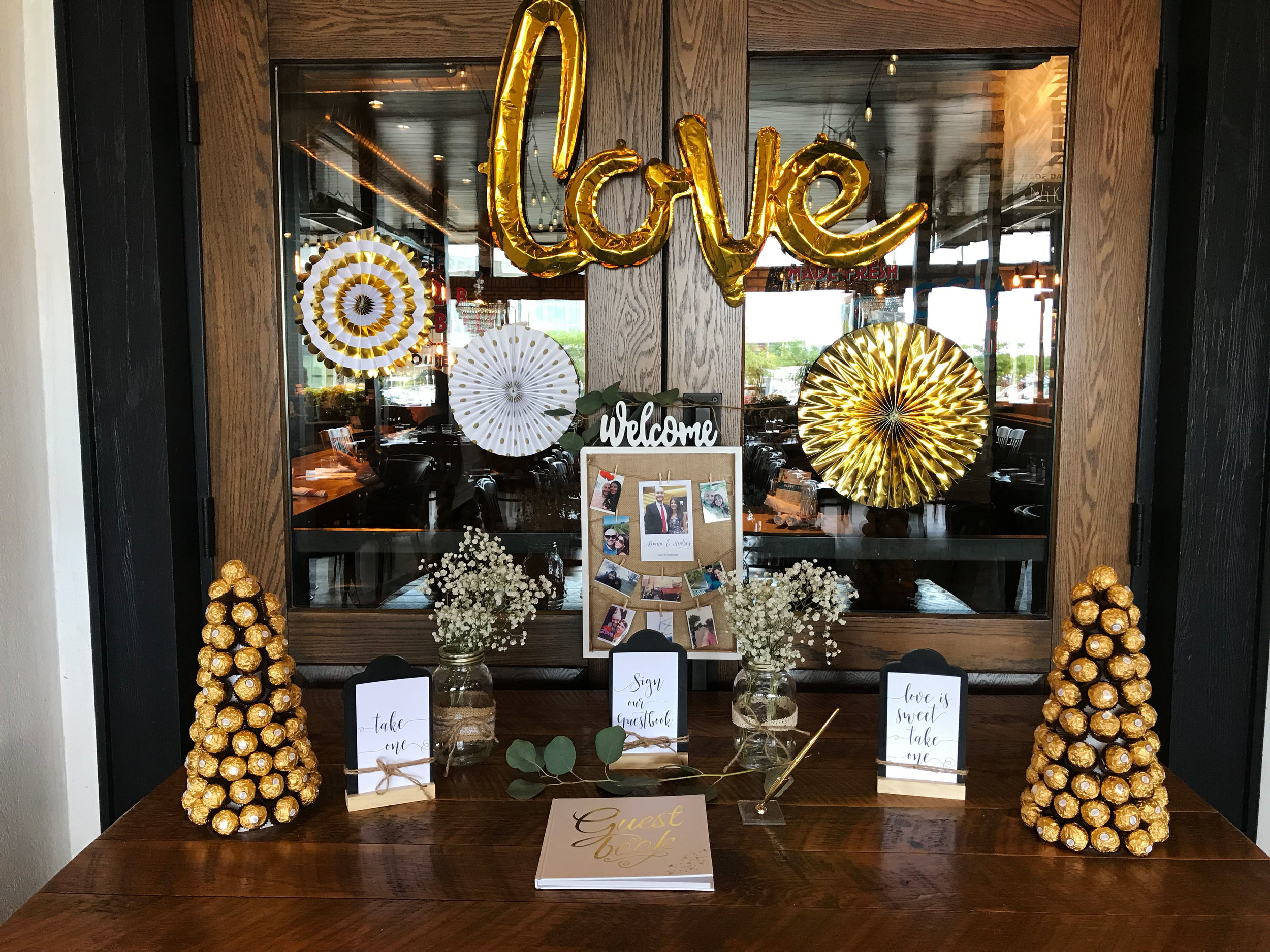 diana-andres-rustic-harvest-welcome-table-Love-ferrer-rocher-polaroid-guestbook-signing-gold-fans.jpg