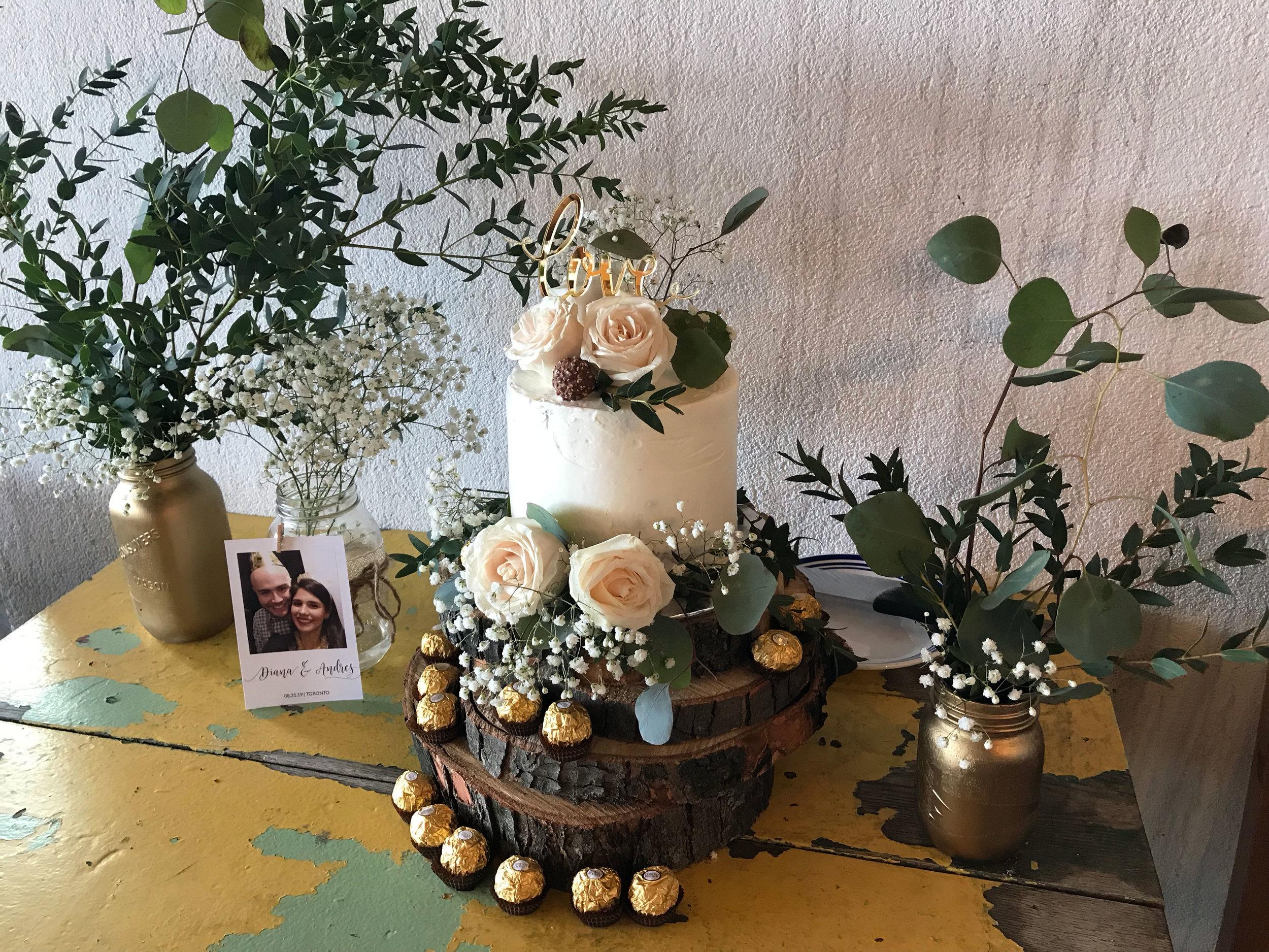 diana-andres-rustic-harvest-cake-table-naked-cake-eucalyptus-wooden-discs-ferrero-rocher-cake-topper-love-polaroid-mason-jar-centerpeices-greenery-tyscany-wedding-2.jpg