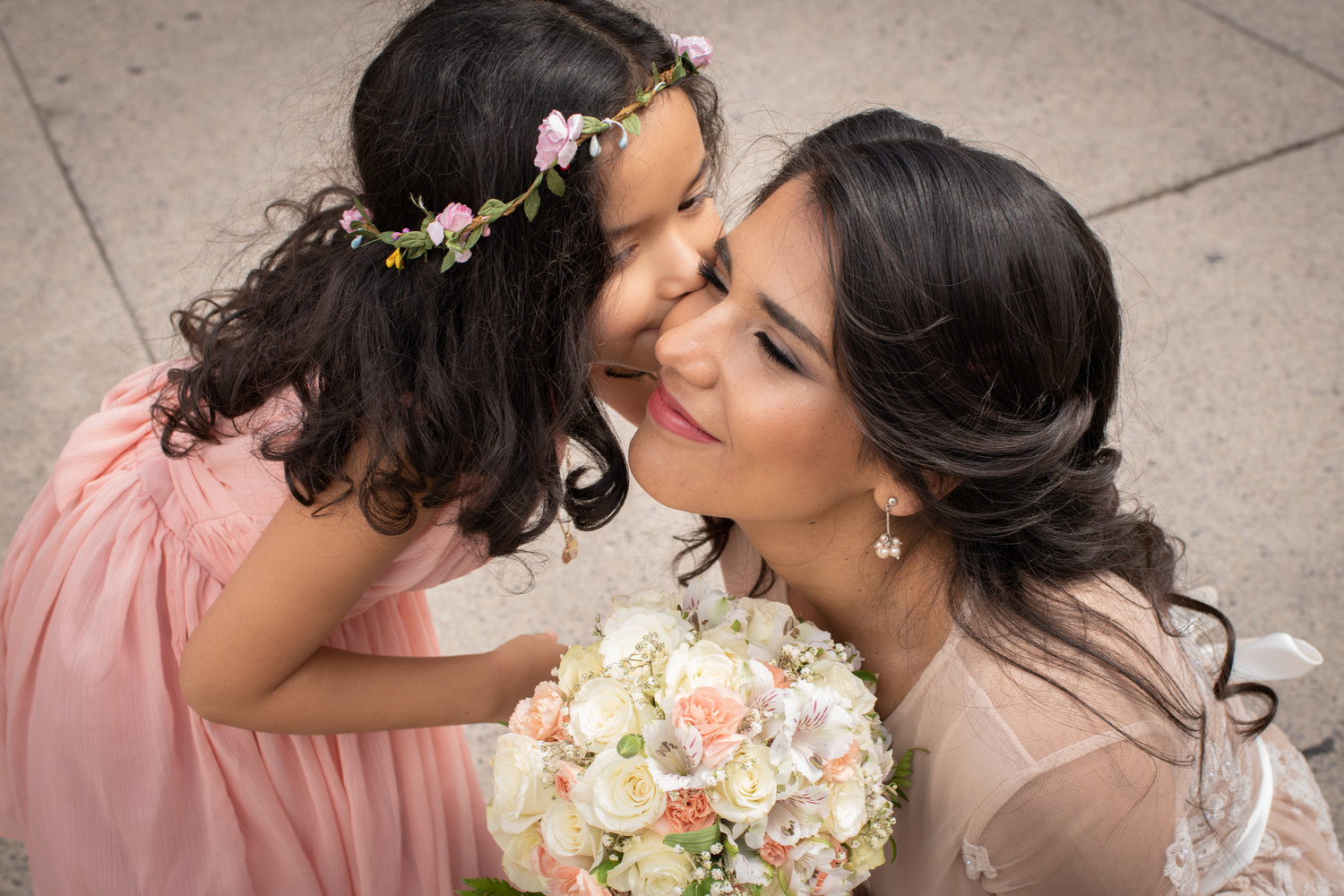 Kisses for the bride.