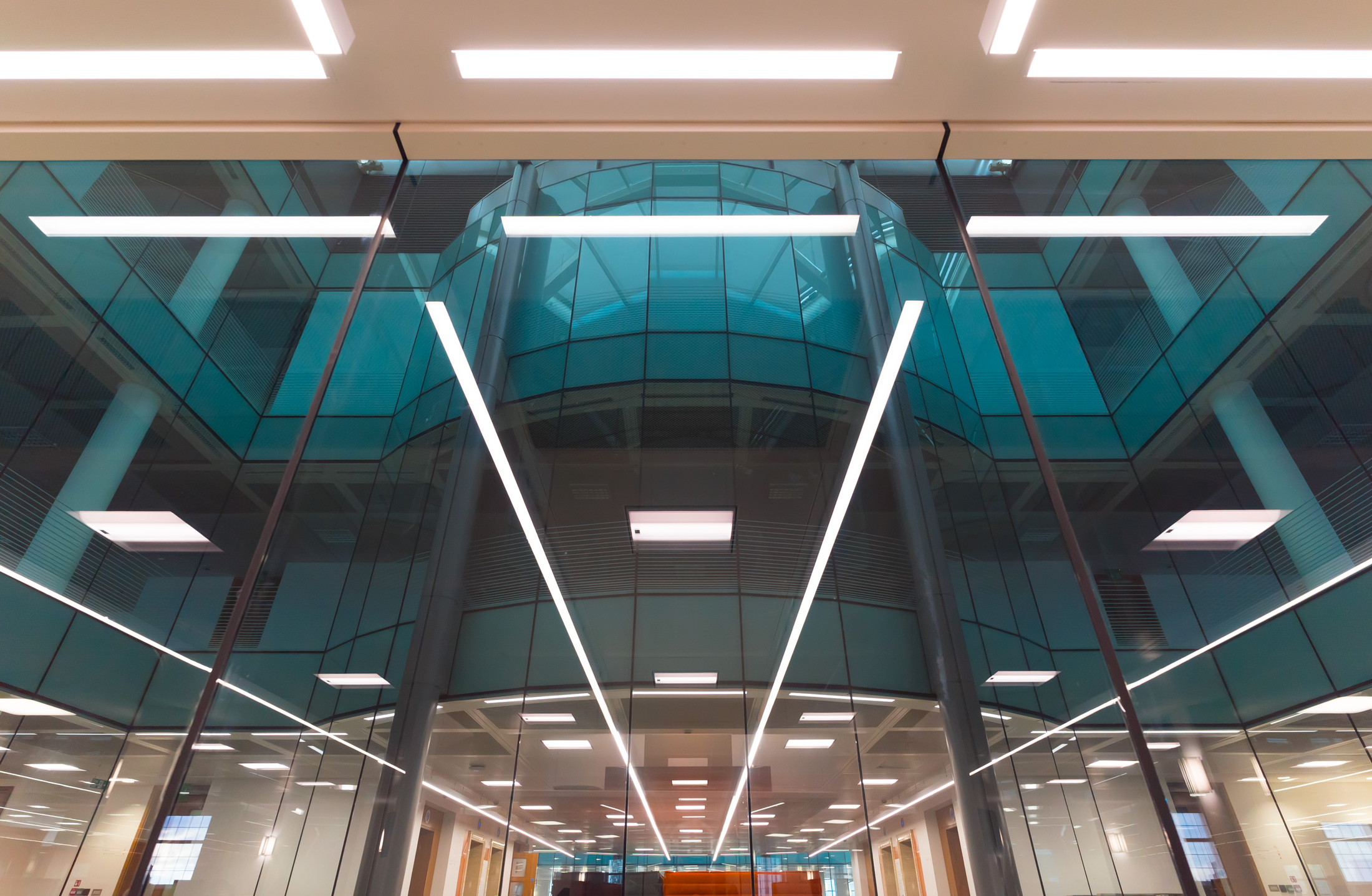 A CUSTOM SOLUTION. - The individual floor plan and design of each floor were calling for a custom solution. The office floors were lit with the linear lighting system Lopen, which perfectly lends itself to custom length solutions.