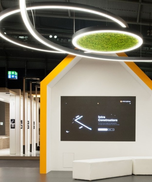 BIOPHILIC DESIGN. - The biophilic trend is here to stay and grow. Incorporating real moss into part of architectural luminaires might sound a bit bonkers, but it is definitely something everyone will talk about! The Slovenian manufacturer Intra lighting integrates moss which is imported from Iceland into their architectural luminaires. Not only is it nice to touch, but its lush green colour really brightens the interior. The moss uses the moisture in the air to live and the lush colour definitely lifts spirits in a workplace or public space. We can't wait to get the first one onto a scheme!