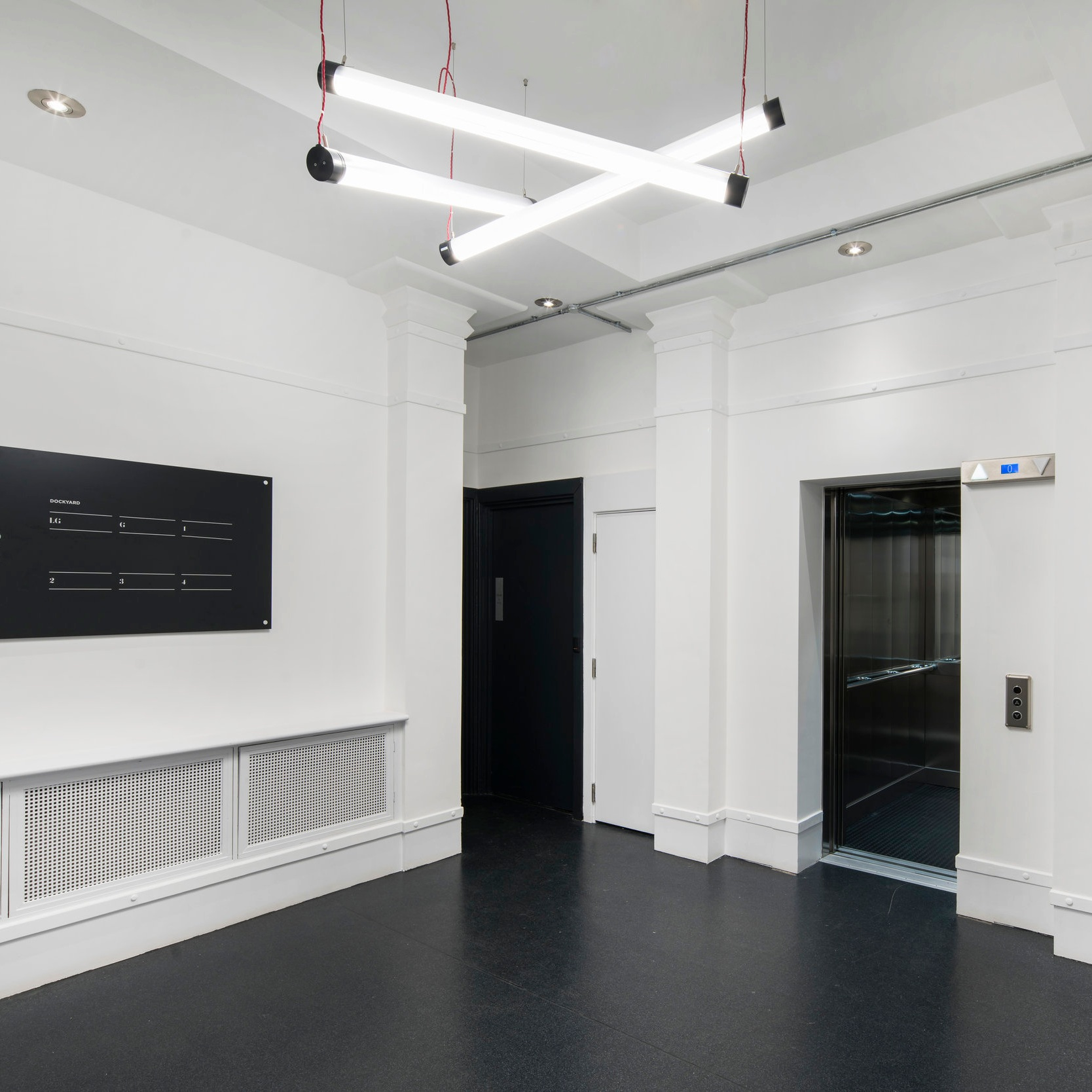 """"""" The design objective for the overall look and feel was to create a blank canvas open plan office space which celebrated the raw and industrial feel of the building. """" - Managing Director 299 Lighting"""