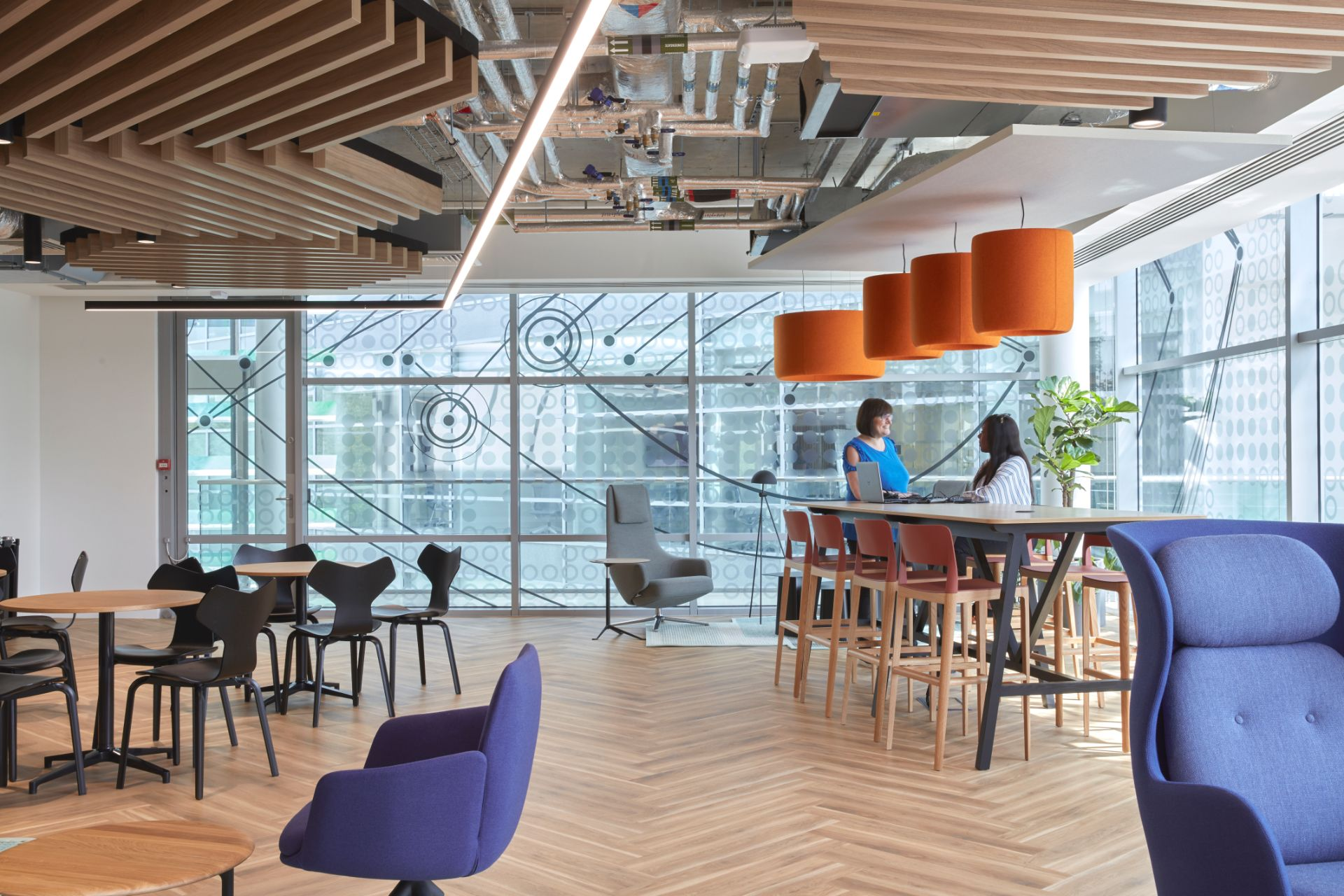THE MAIN DESIGN BRIEF. - The main design brief was to create a contemporary workplace, tailored to the specific - angled shape of the building. The scheme is influenced by industrial style exposed ceilings and services, crisp-white dropped ceiling and acoustic panels bringing texture, a pop of colour and playfulness.