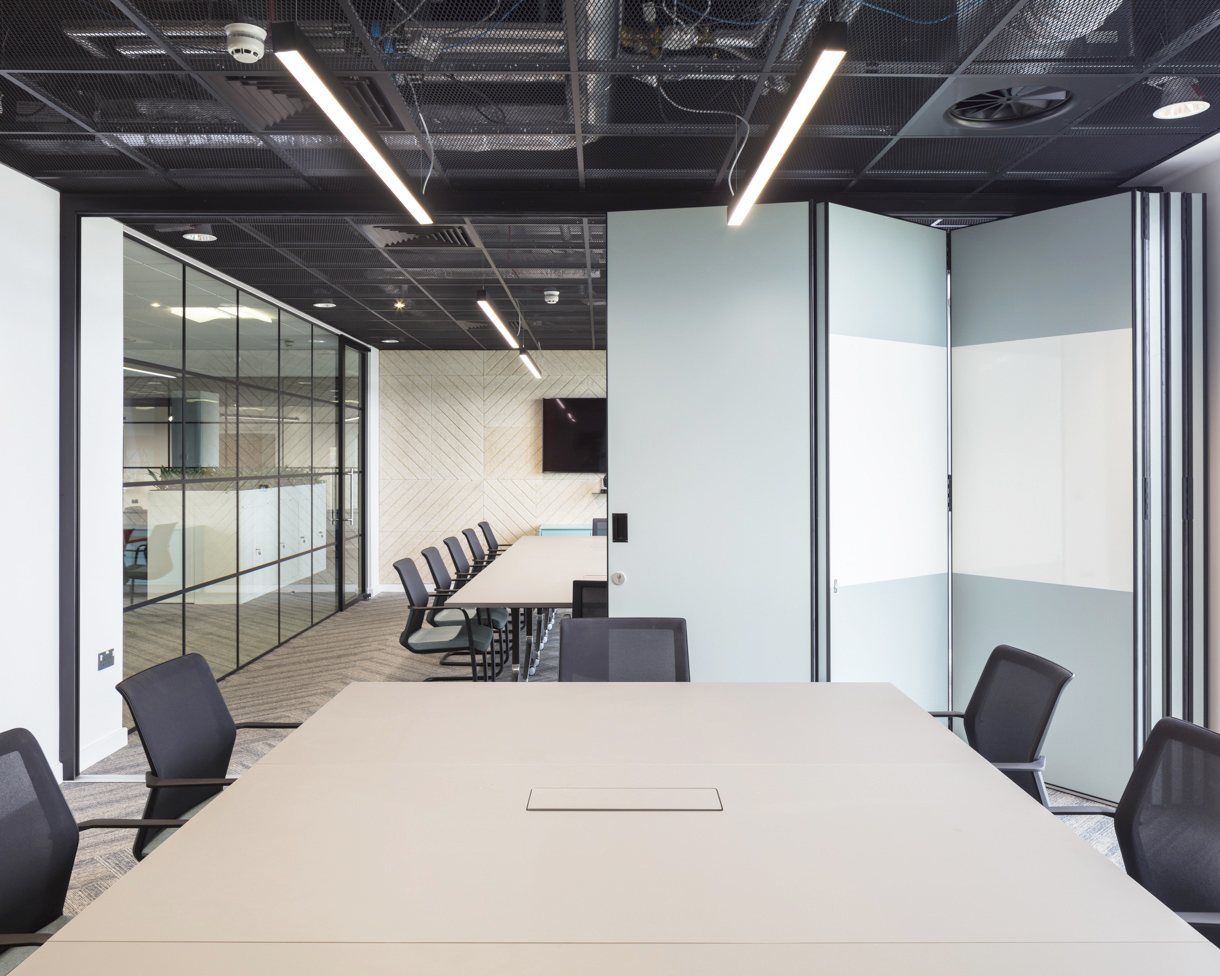 LINEAR OFFICE LIGHTING. - All linear office lighting was supplied in a contemporary matt black finish, perfectly bringing the colour scheme together.
