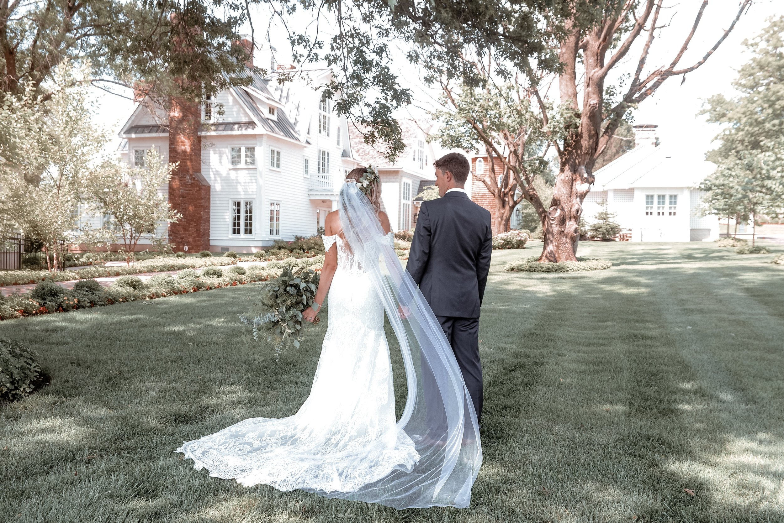 """View from the back! Also my veil was my """"something borrowed"""". It was my sister's on her wedding day— made by my aunt!"""