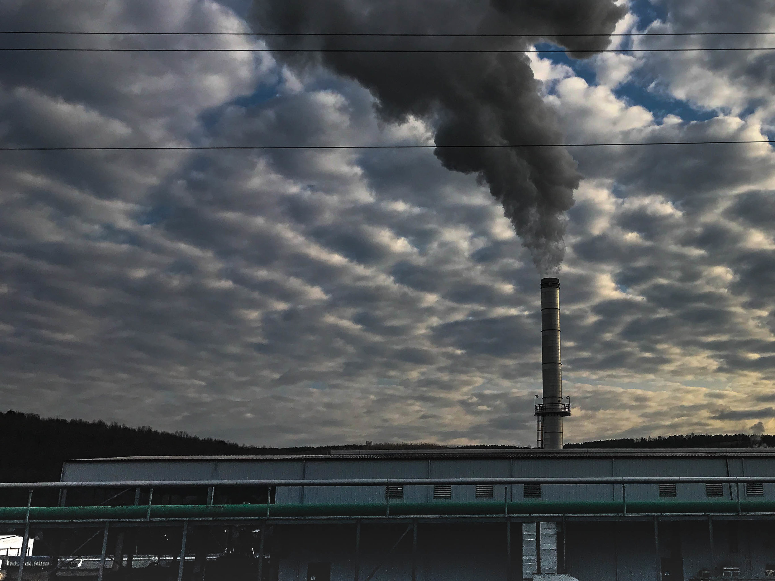 Consider how the clouds are collecting what is rising out of this mill, a long-time employer for a small town in Pennsylvania. Smoke stacks like this frequently sit in towns, or just outside of them. Next time you see one, look around at the community who gets the rain from it next.