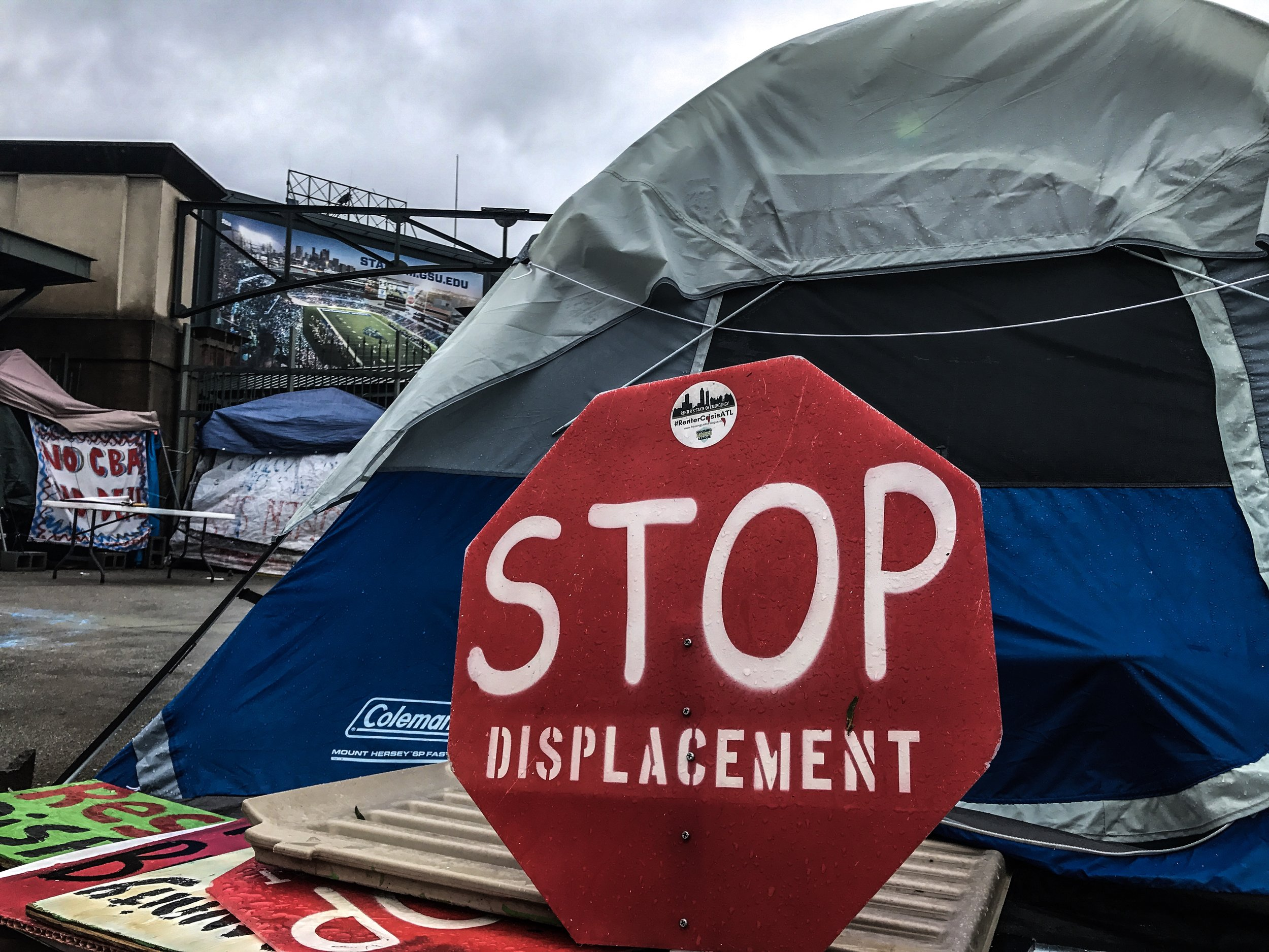 Outside the Atlanta Braves stadium, a statement by local long-time residents, people of color, who were being displaced by the re-zoning of the city in favor of upscale economic development.