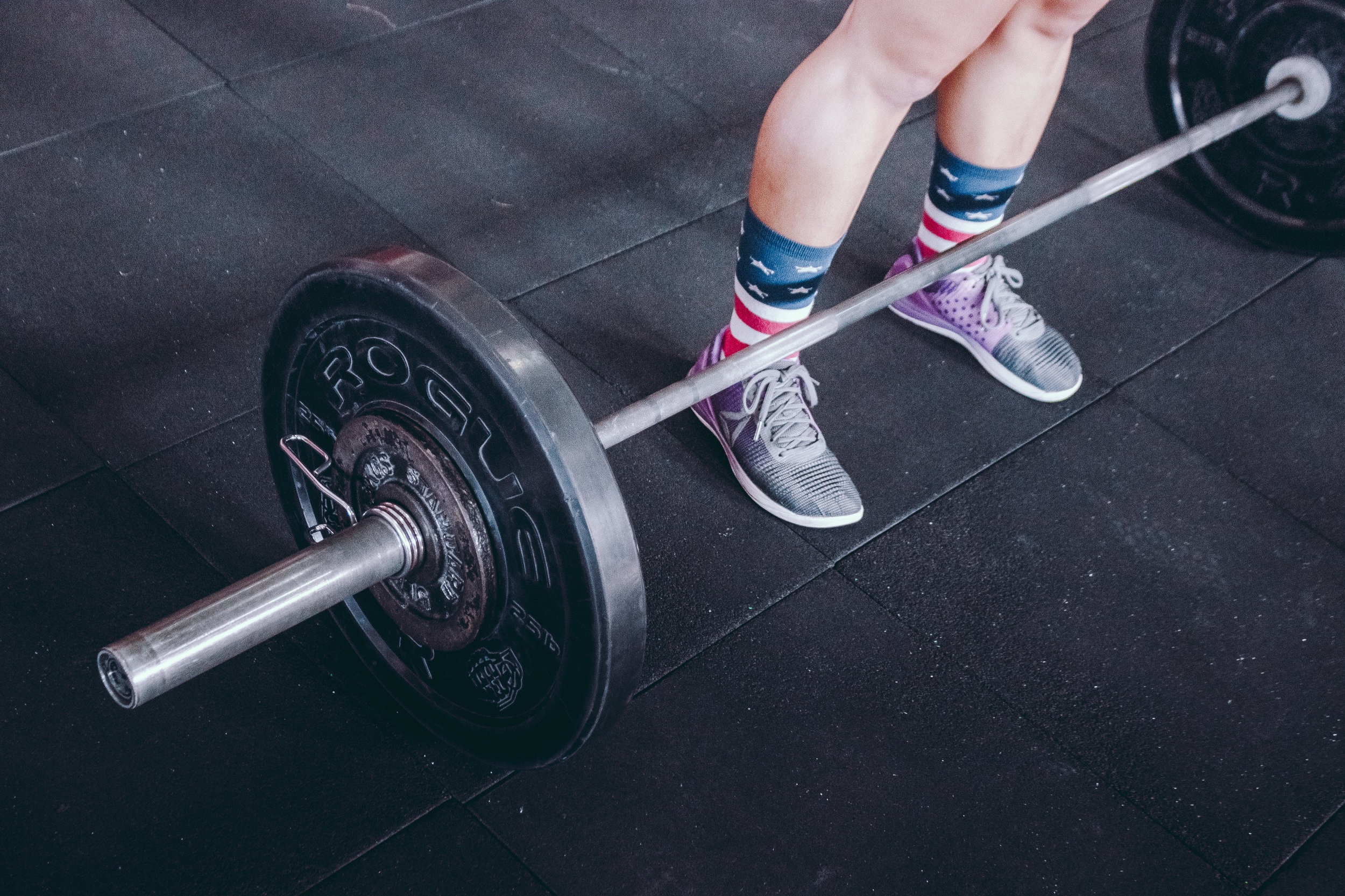 large barbell resting on the floor