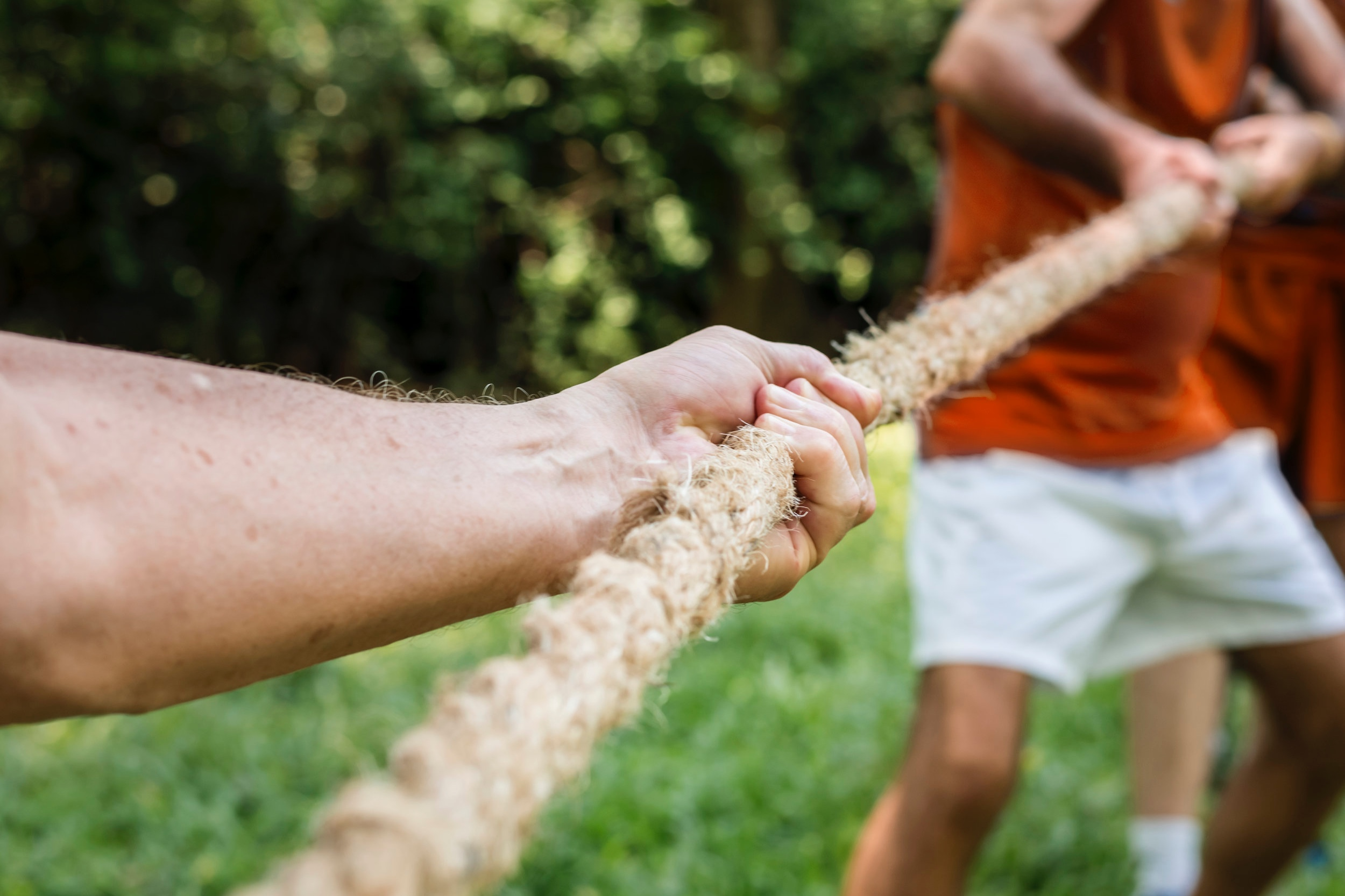 hands holding a tug-of-war rope