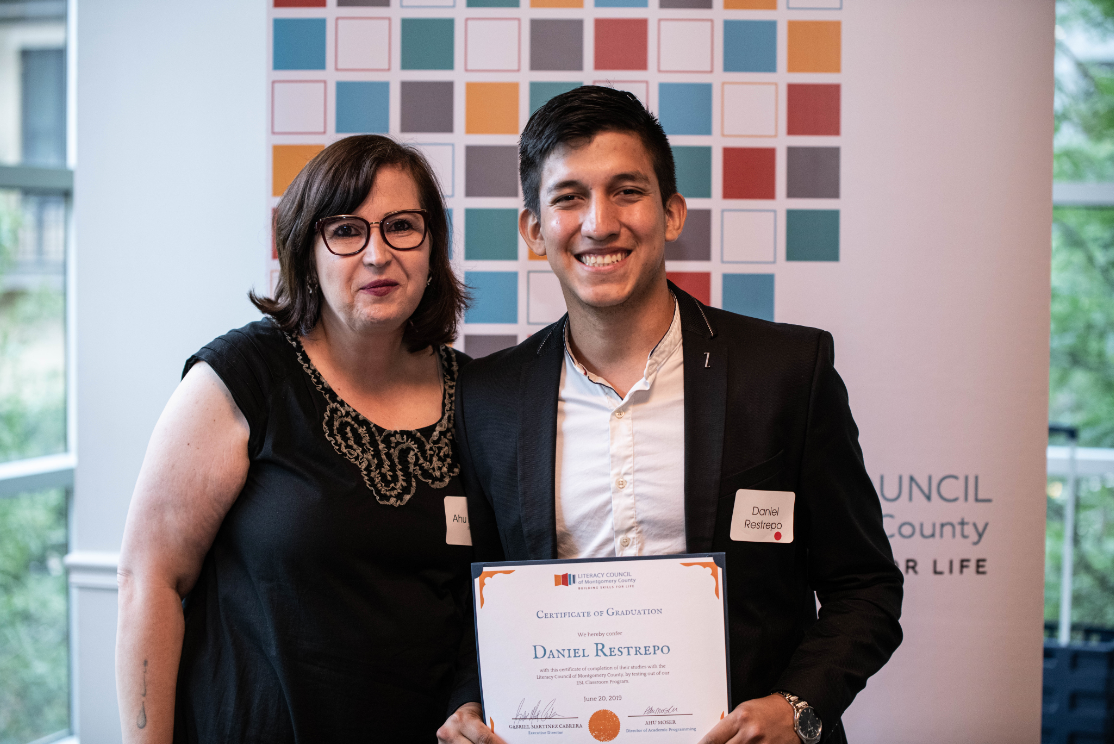 ESL Classroom program graduate Daniel with LCMC's Director of Academic Programming, Ahu Moser.
