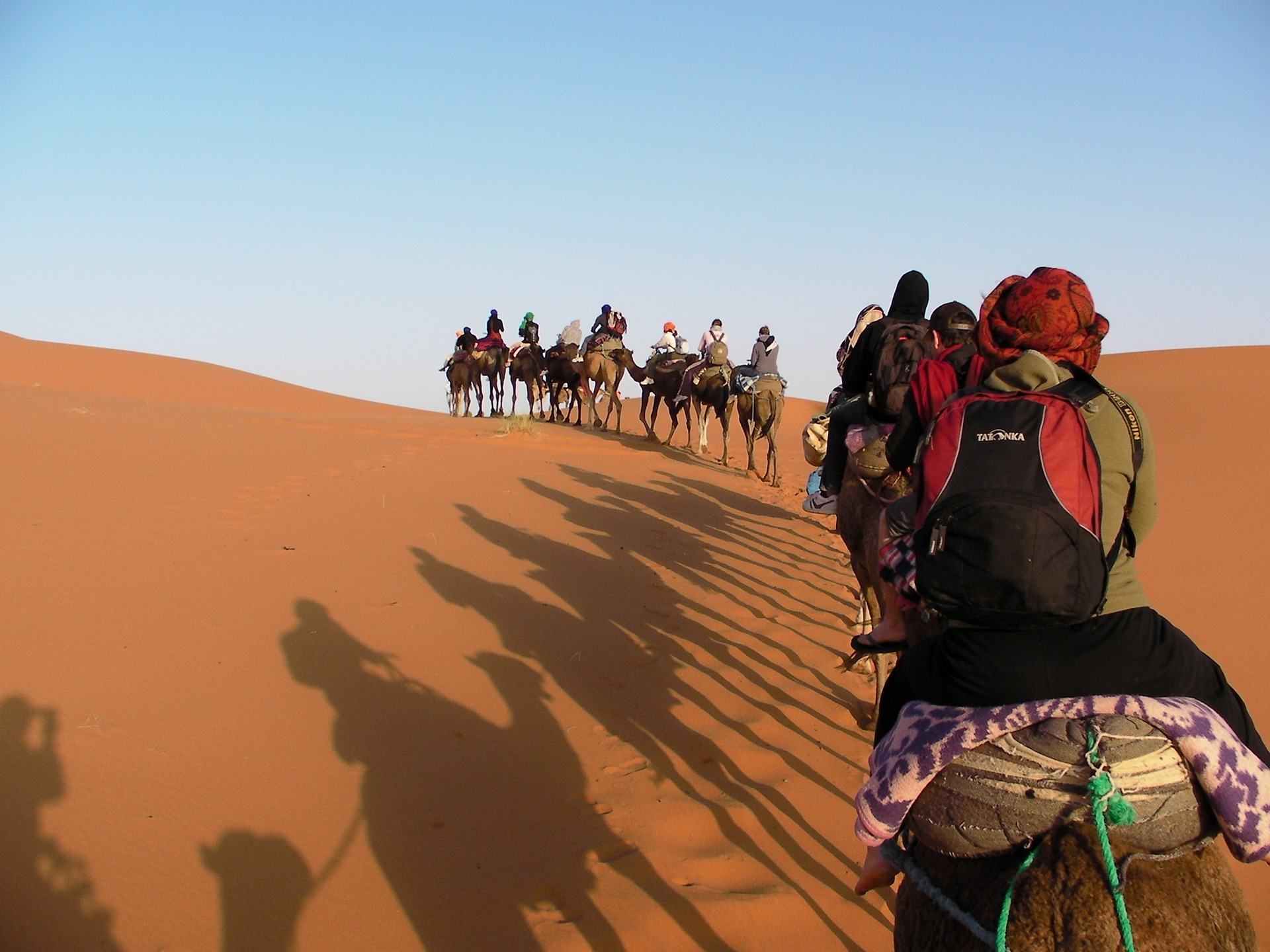 Camel trekking - Start the camel trip from Merzouga, the nearest village to Erg Chebbi and take you into Erg Chebbi for an hour and along the way you will take a stop to enjoy the sunset on top of the sand dune before arrival to the camp.