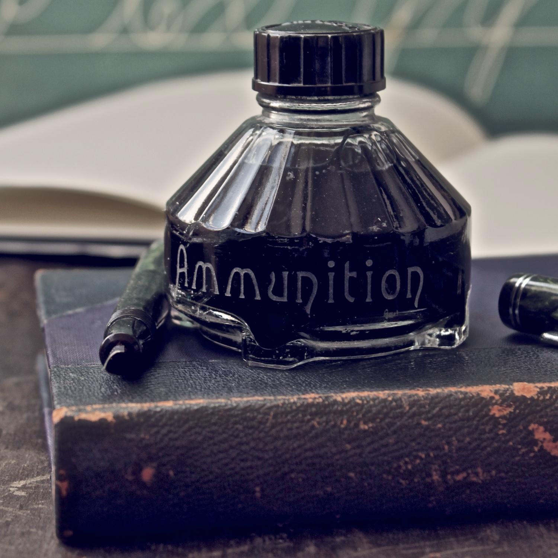 ammunition-etched-vintage-ink-bottle-vinegar-and-brown-paper.jpg