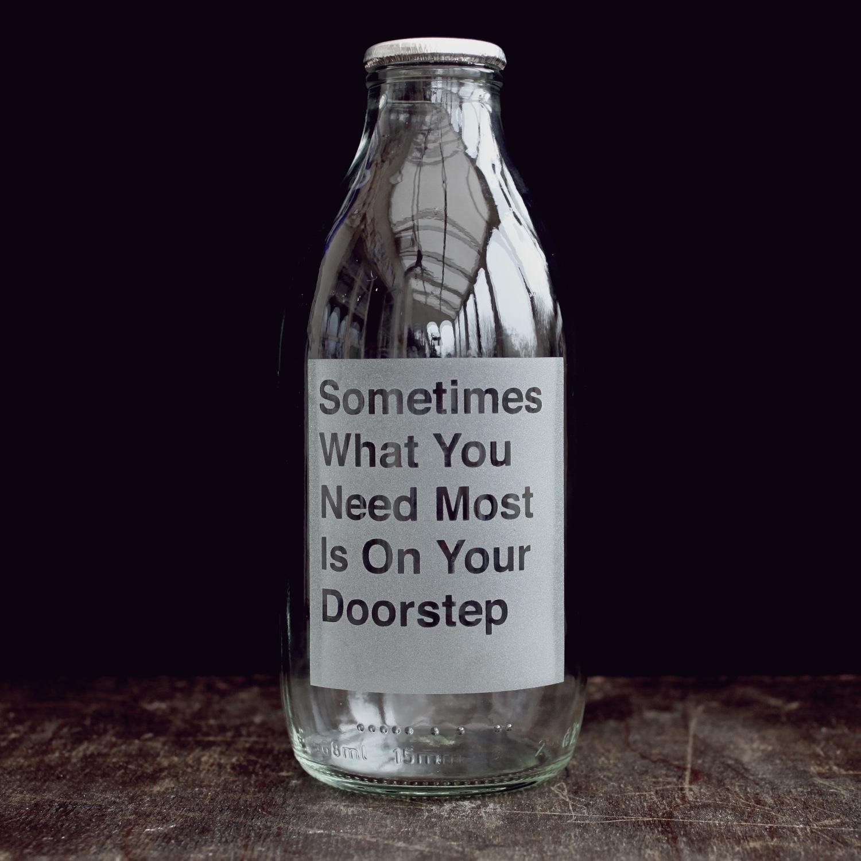on-your-doorstep-etched-milk-bottle-vinegar-and-brown-paper.jpg