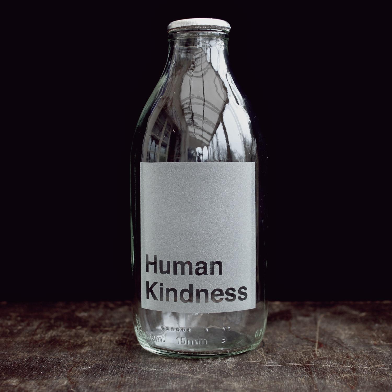 human-kindness-etched-milk-bottle-vinegar-and-brown-paper.jpg