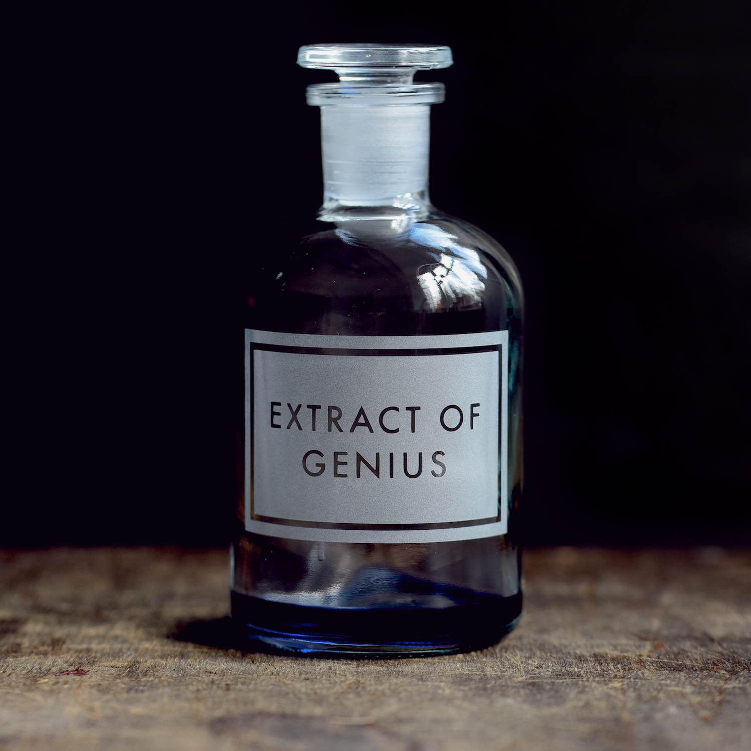 extract-of-genius-etched-apothecary-bottle-vinegar-and-brown-paper.jpg