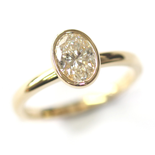 Yellow Gold Rub Set Oval Cut Diamond Engagement Ring.jpg