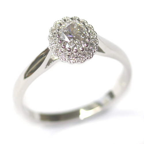 Platinum Oval Cut Diamond Halo Engagement Ring.jpg