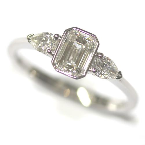 Platinum Pear and Emerald Cut Diamond Trilogy Engagement Ring.jpg